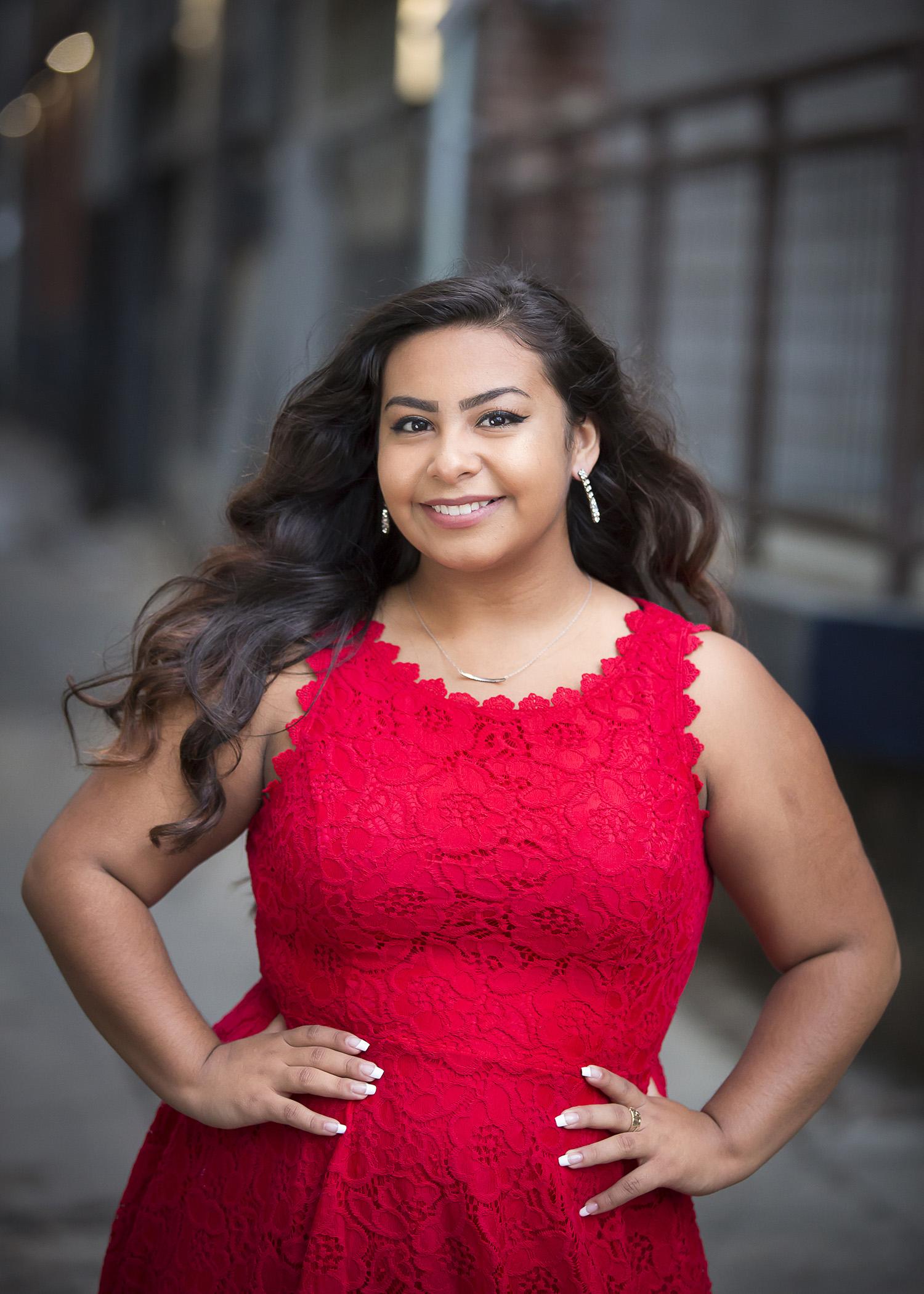 Latina High School Senior Girl rocking red dress, photographed in Denver alley with photographer Jennifer Koskinen, Merritt Portrait Studio