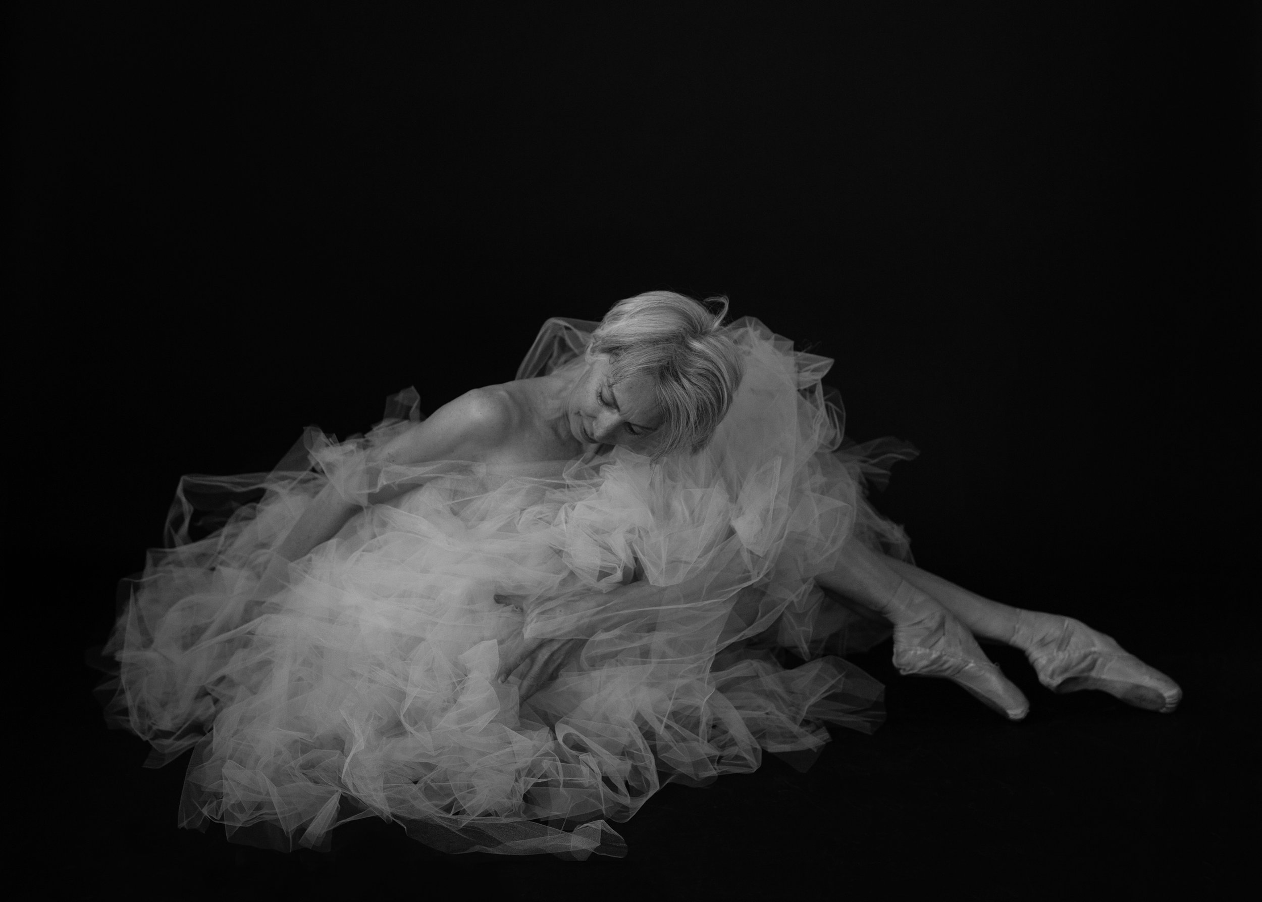 Valerie Madonia dances in cradle of tulle for black and white fine art photo shoot with photographer Jennifer Koskinen, Merritt Portrait Studio