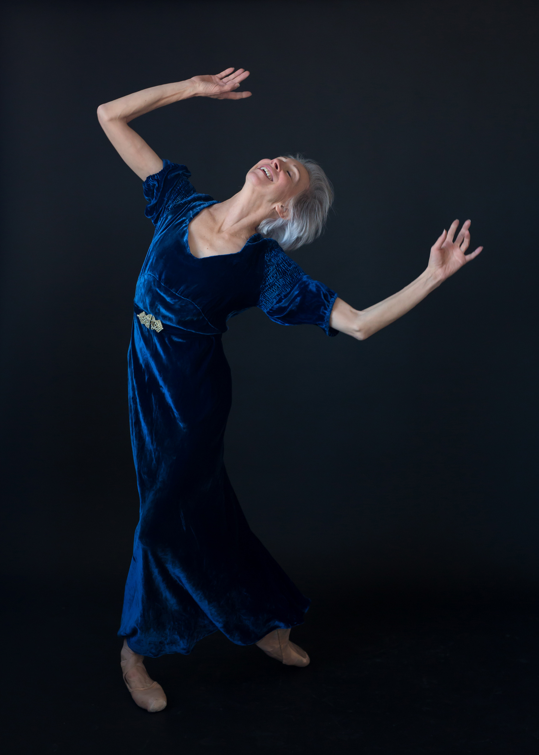 Valerie Madonia dances in vintage velvet during photo session with Denver dance photographer Jennifer Koskinen, Merritt Portrait Studio
