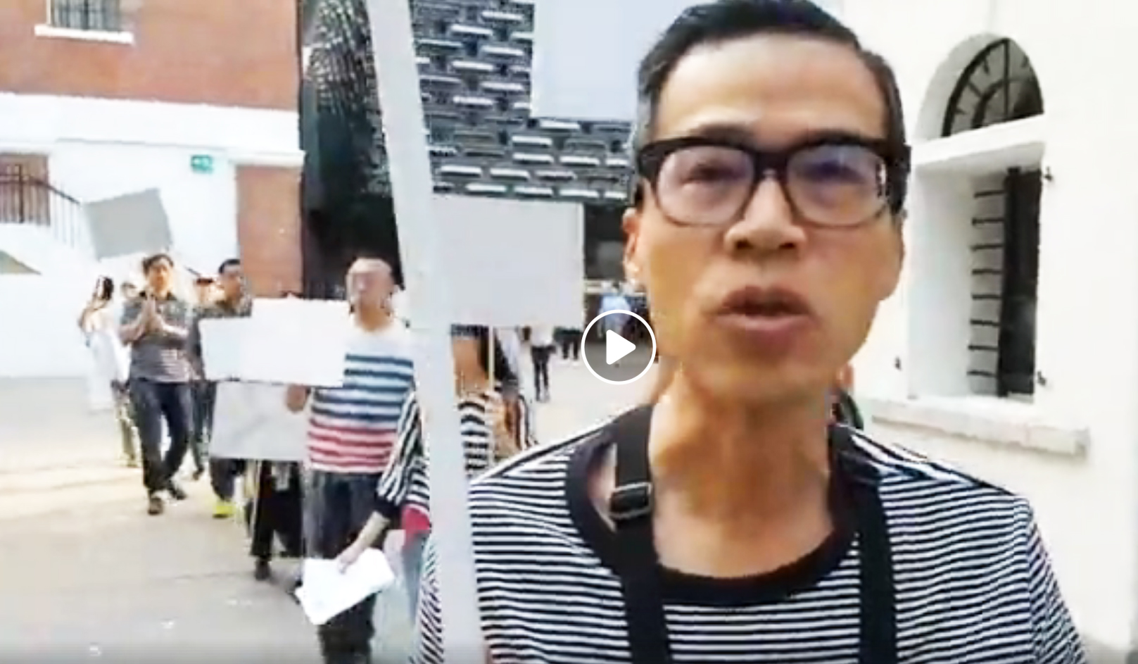 """Nov/18/2018 HKFP_Live  A group of artists - including  Kacey Wong  - are holding a white placard """"non-protest"""" performance in favour of free expression at art space 大館 Tai Kwun."""