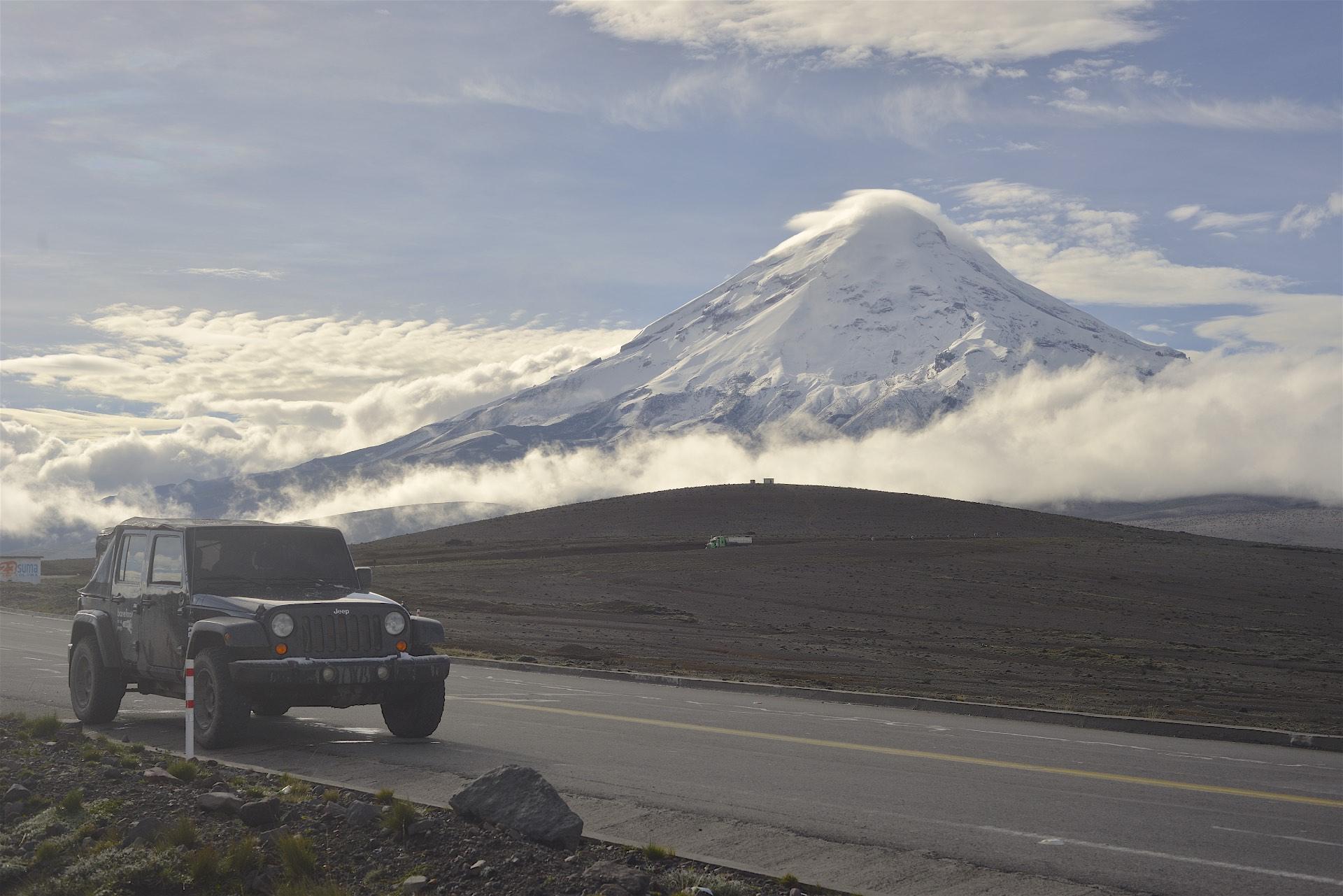 Chimborazo volcano behind the Jeep. 6300 meters.