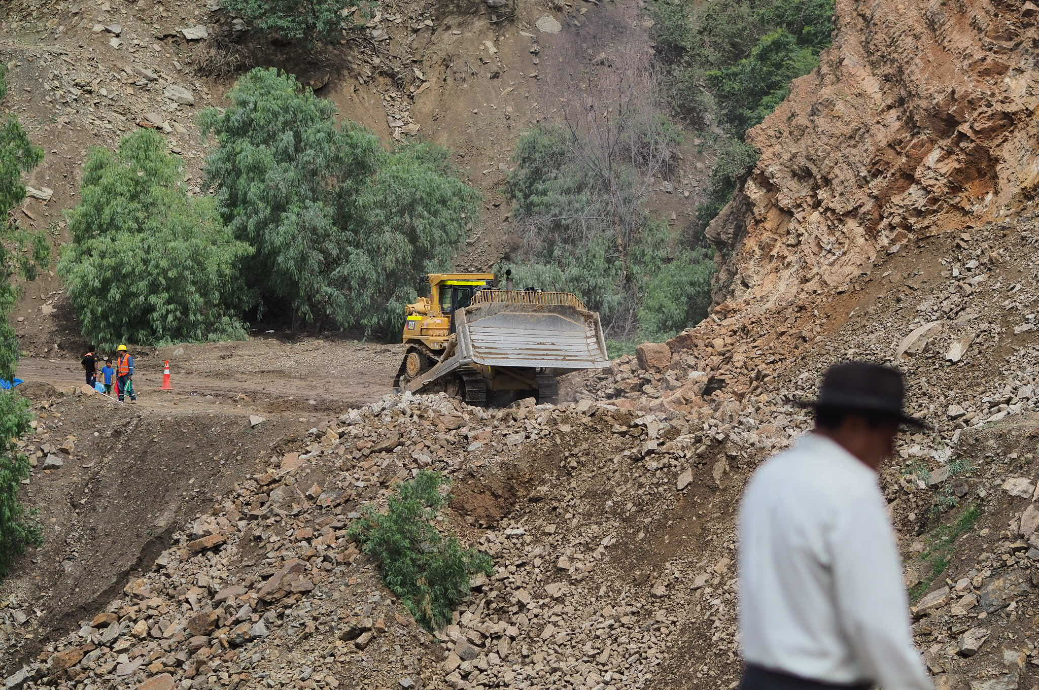 A crew is clearing the highway after a landslide blocked it.