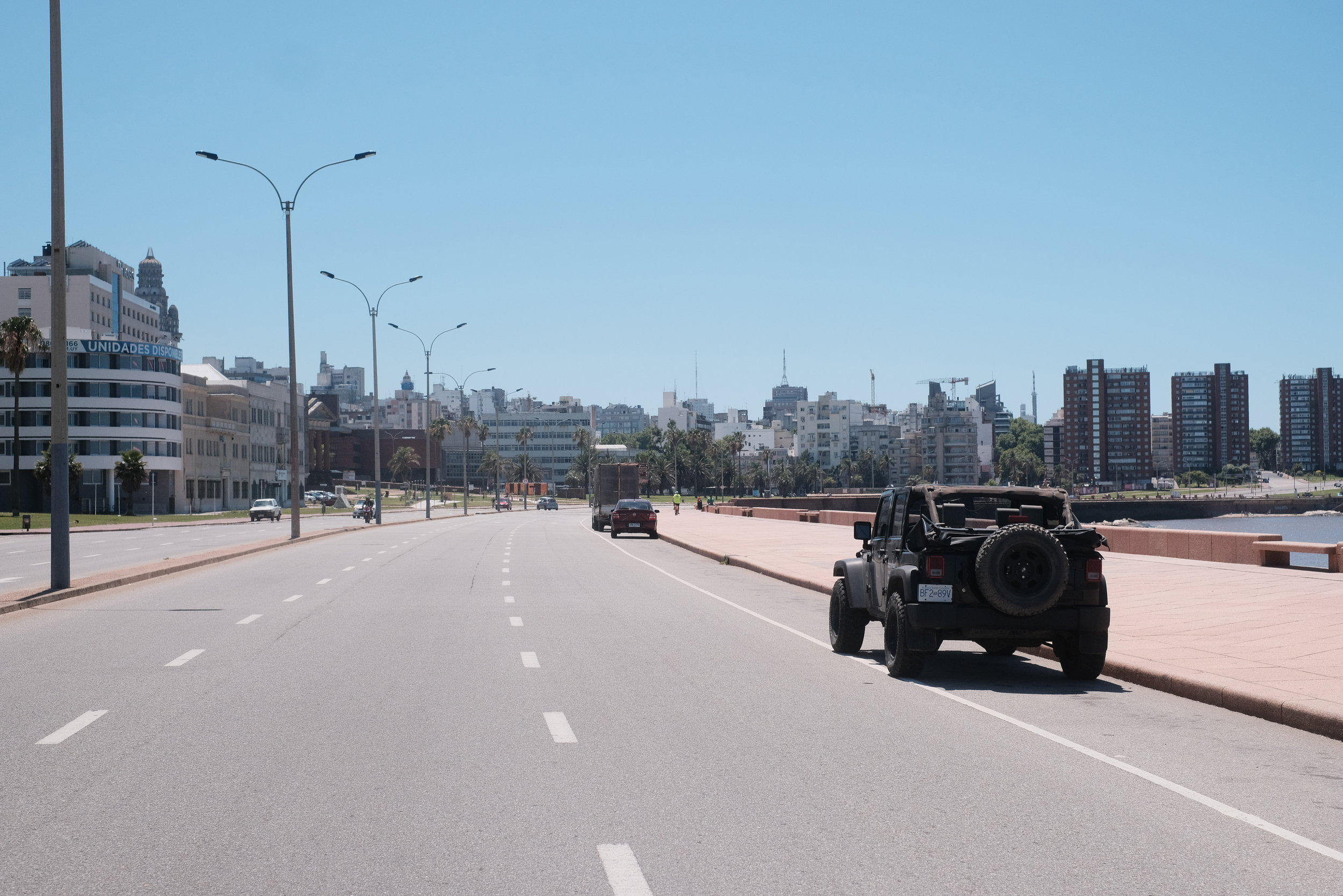 Good life decision can lead one to drive in Montevideo in a convertible Jeep.