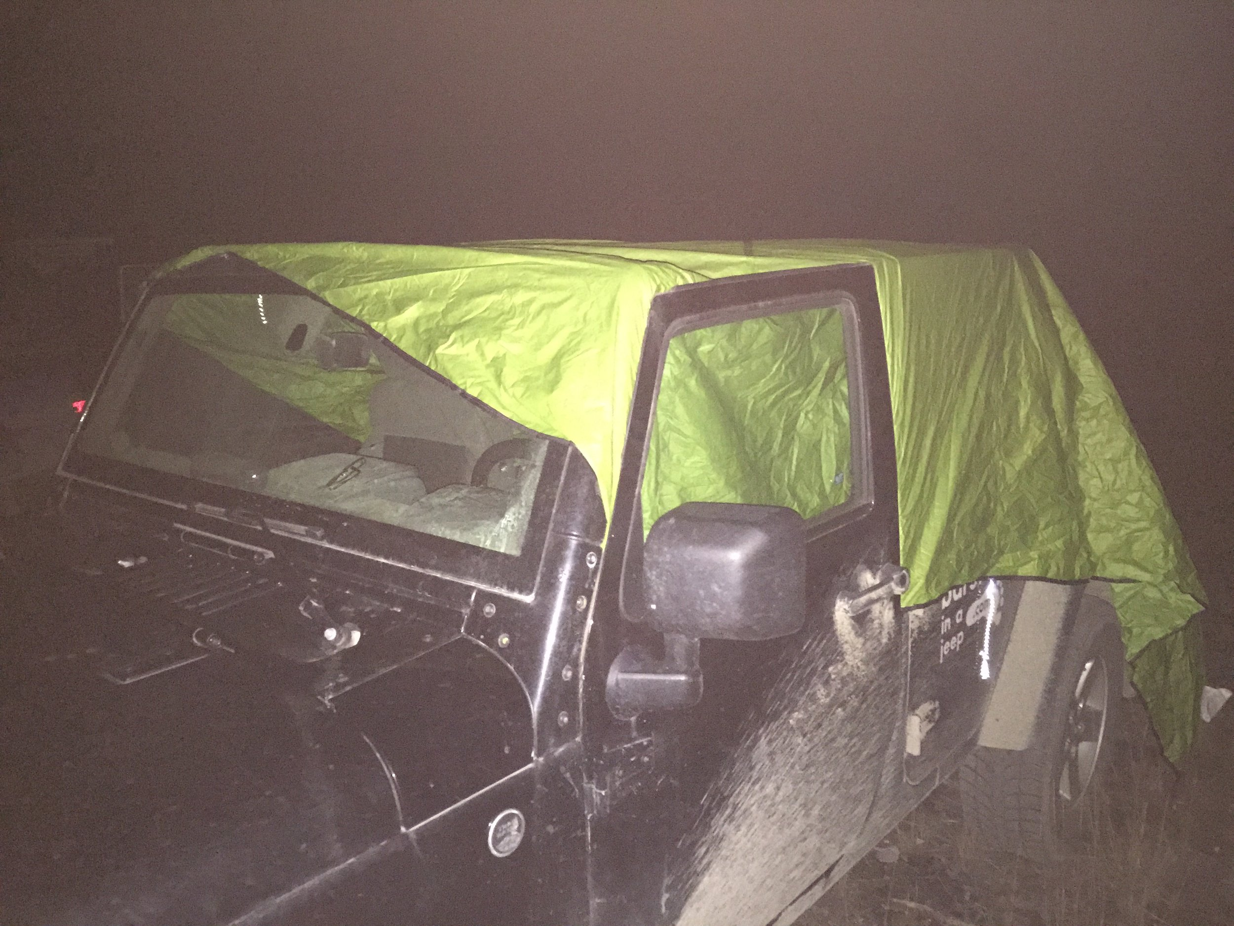 I had left my roof at a friend's place, 200 kilometres away. One thing led to the other and I decided to camp with some friends in a remote part of northern Canada. My friend had a weatherproof canvas: we made a makeshift roof for the Jeep and I had a comfortable night at the back of the Jeep.