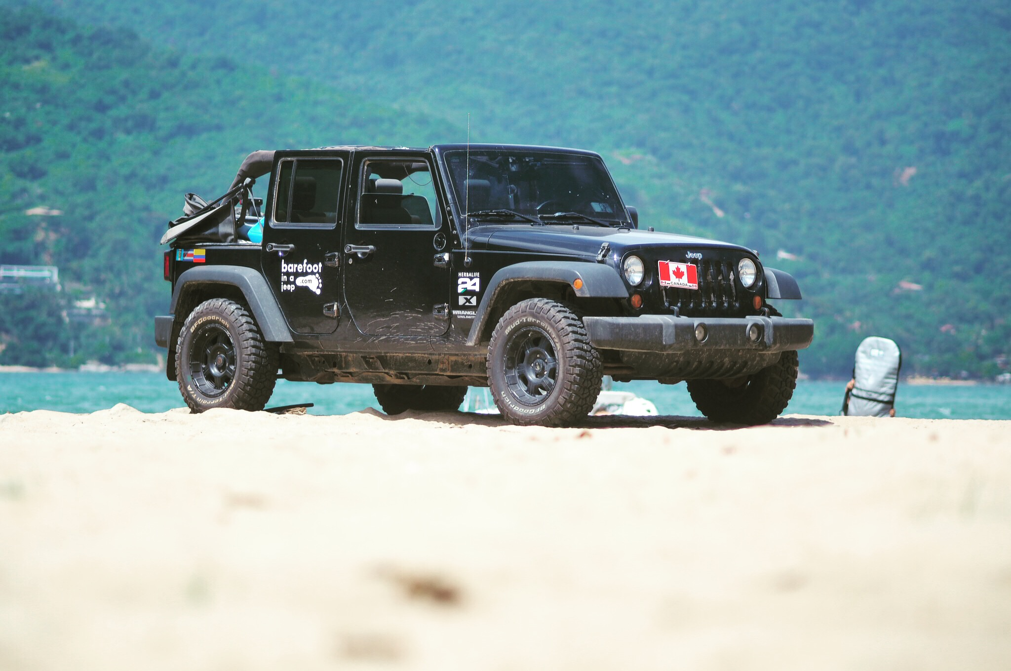 The Jeep standing proudly on a beach in Floripa's beach, Brazil.