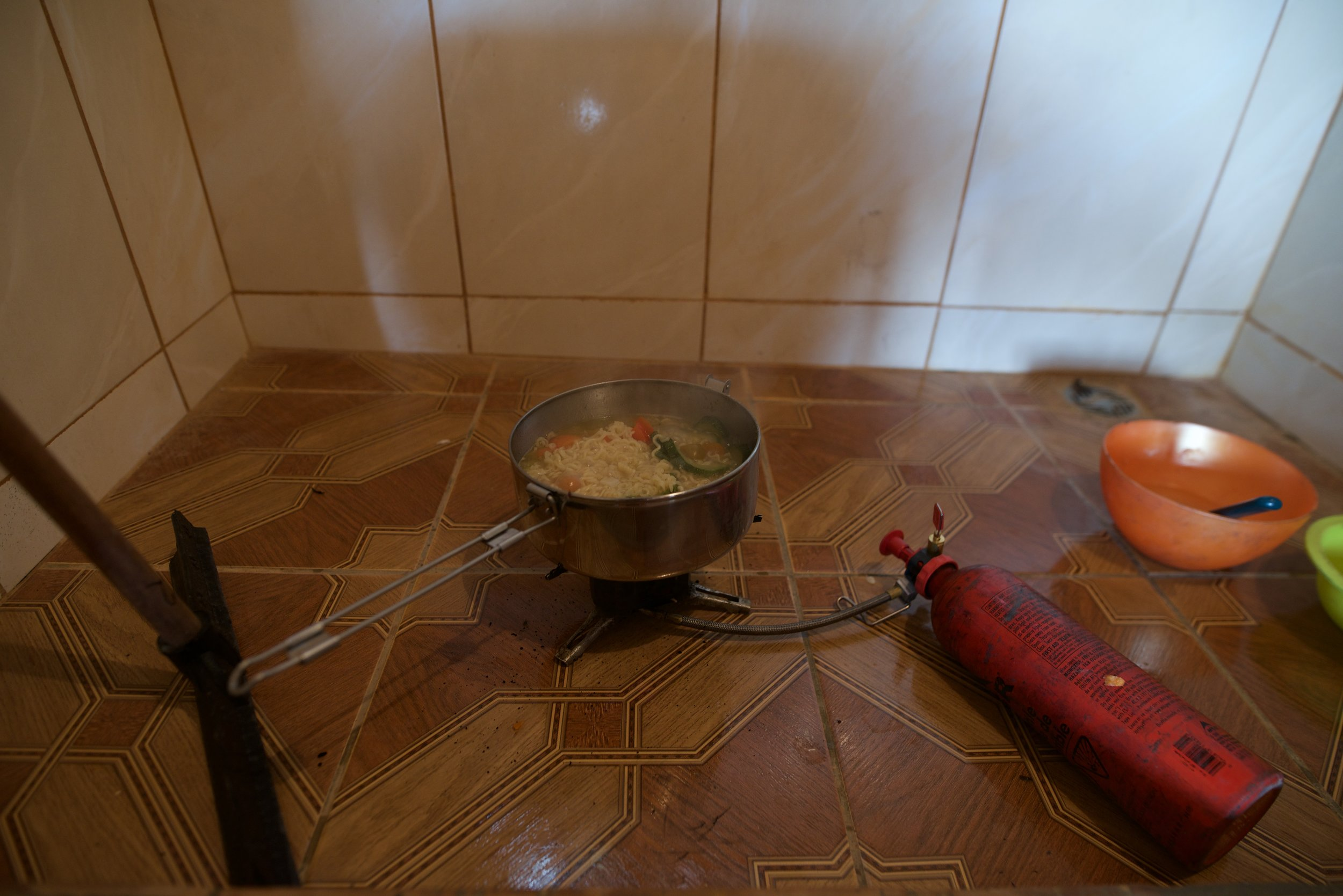 Cooking in the shower in Bolivia. I used a  XGK EX  stove from MSR for a decade without a single issue: Literally the best prepper/overlander stove on the market. I used all kinds of fuel. Never costed me more than a dollar a week to cook as much as I want. The best $200CAD ever spent.