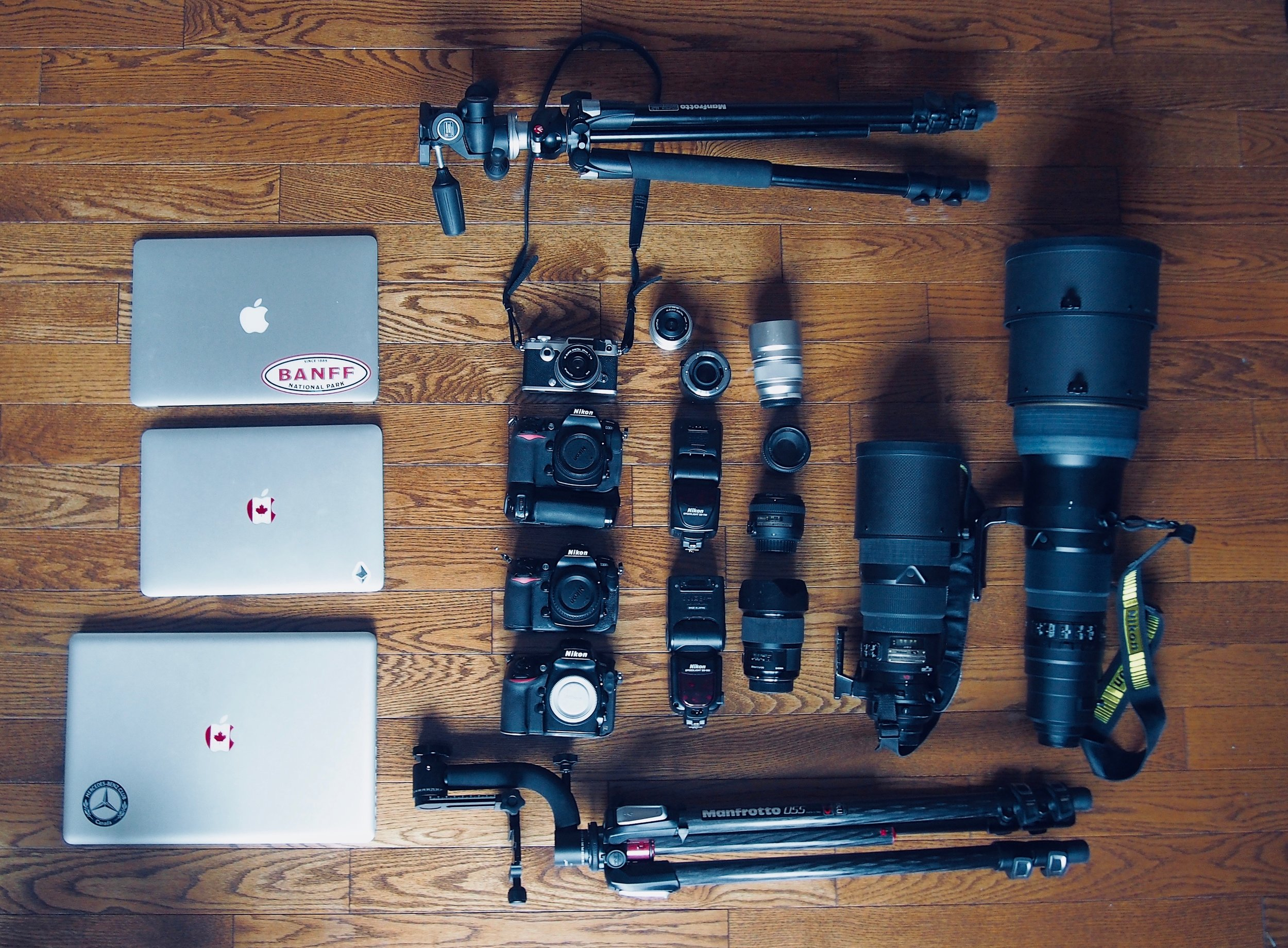"""Things I carried: two laptops, a Pen-F, a D300, a D300s, a D800E, a 20mm f/1.4 Sigma Art, a 50mm f/1.4 AF-S G, a 50mm f/1.8 AF-D, a 300mm f/2.8 VR, a 600mm f/4 VRII nano-crystal, two manfrotto tripod, a sb-900 and a sb-700 (which I came to hate), a Olympus Pen-F with a 75mm f/1.8 Zuiko and 17mm f/1.8, a 17"""" Macbook Pro 2011 quad-core, a late 2012 13"""" Macbook pro retina. The Macbook Air belongs to my sister and is on this picture only because it looked cool at that time haha."""