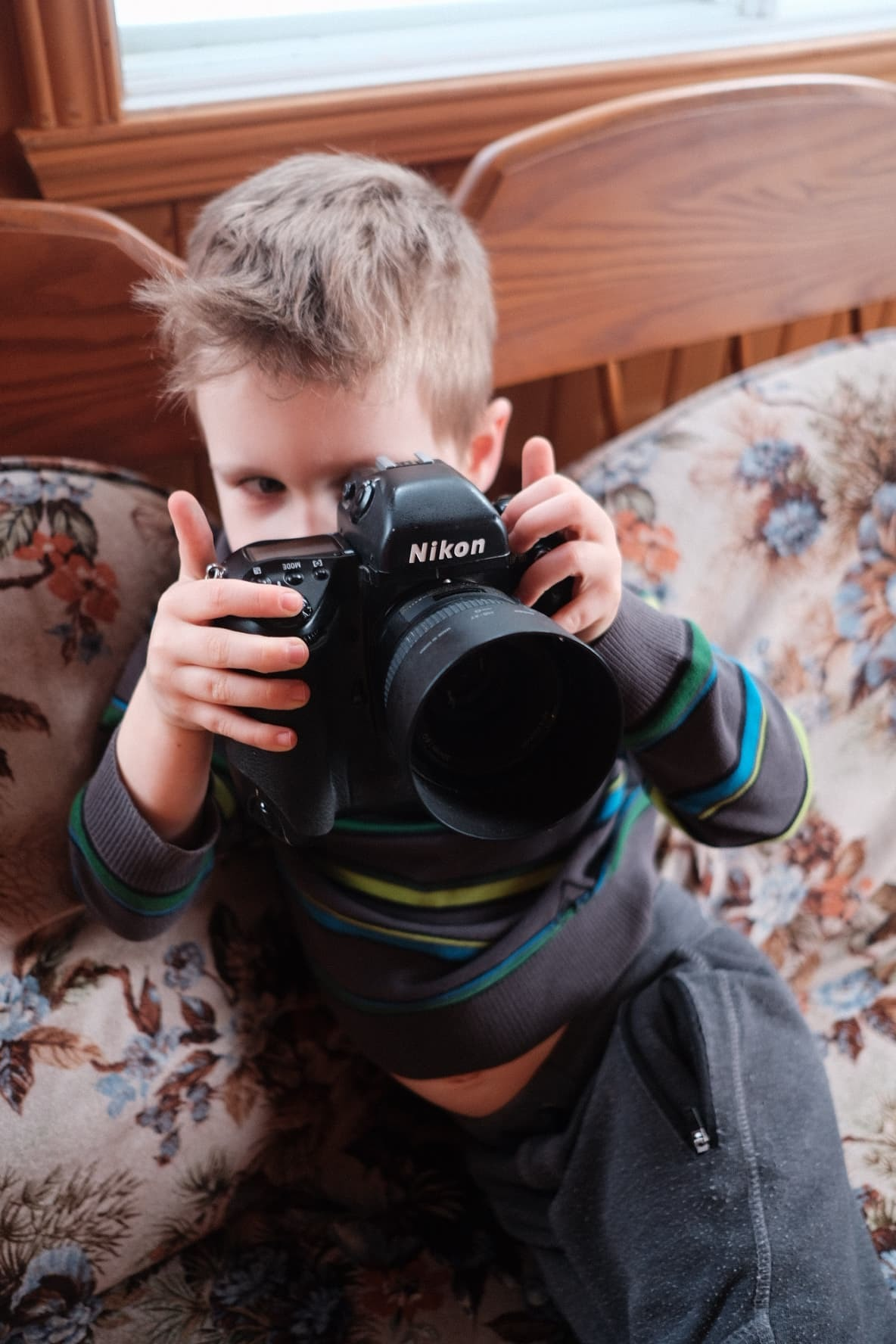 Nephew having fun with the Nikon F5. Taken with the 23mm f/2.0 Fuji wide open.