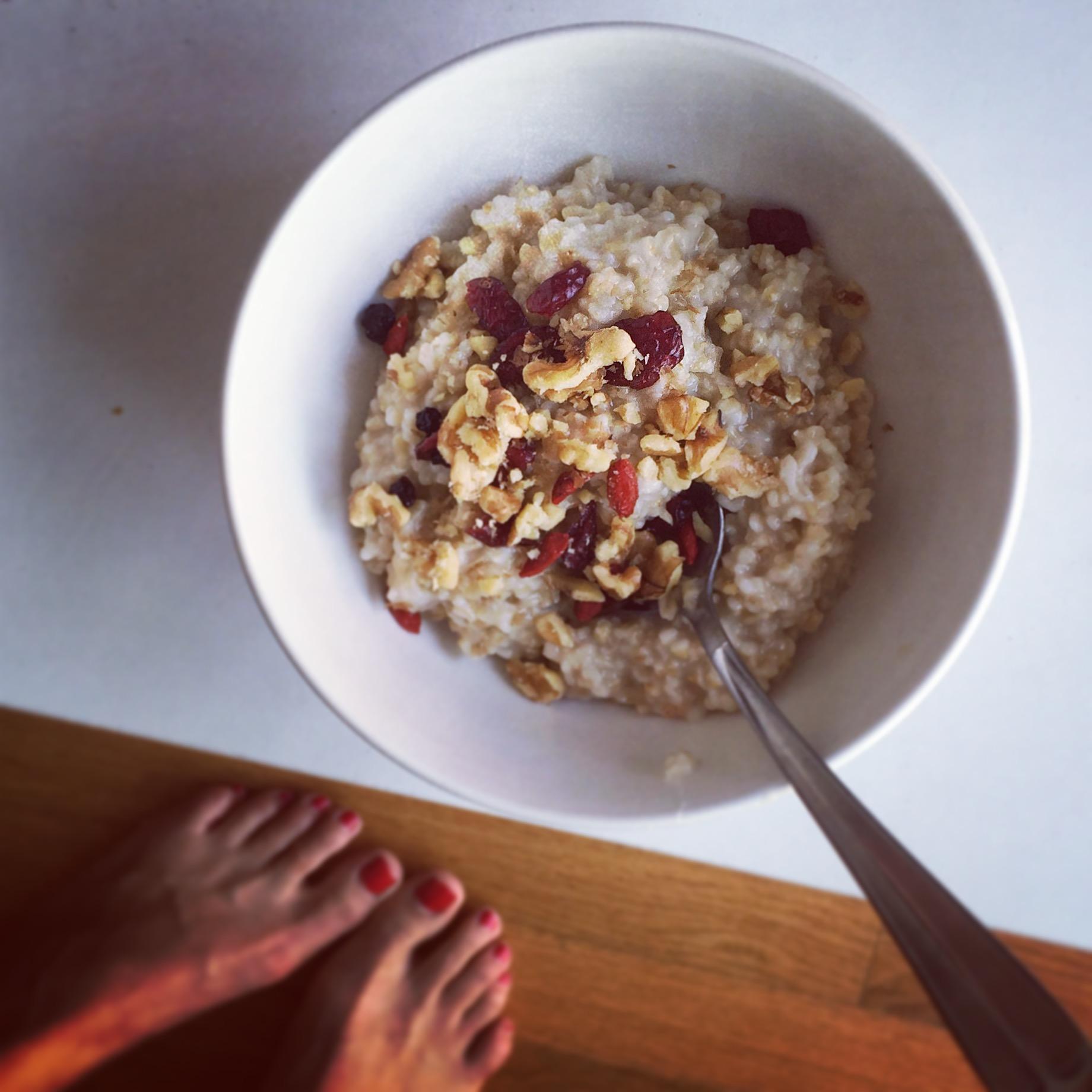 Gluten-free steel cut oats, crushed raw walnuts, raw farm honey, cinnamon, organic dried berries with a cup of green tea.