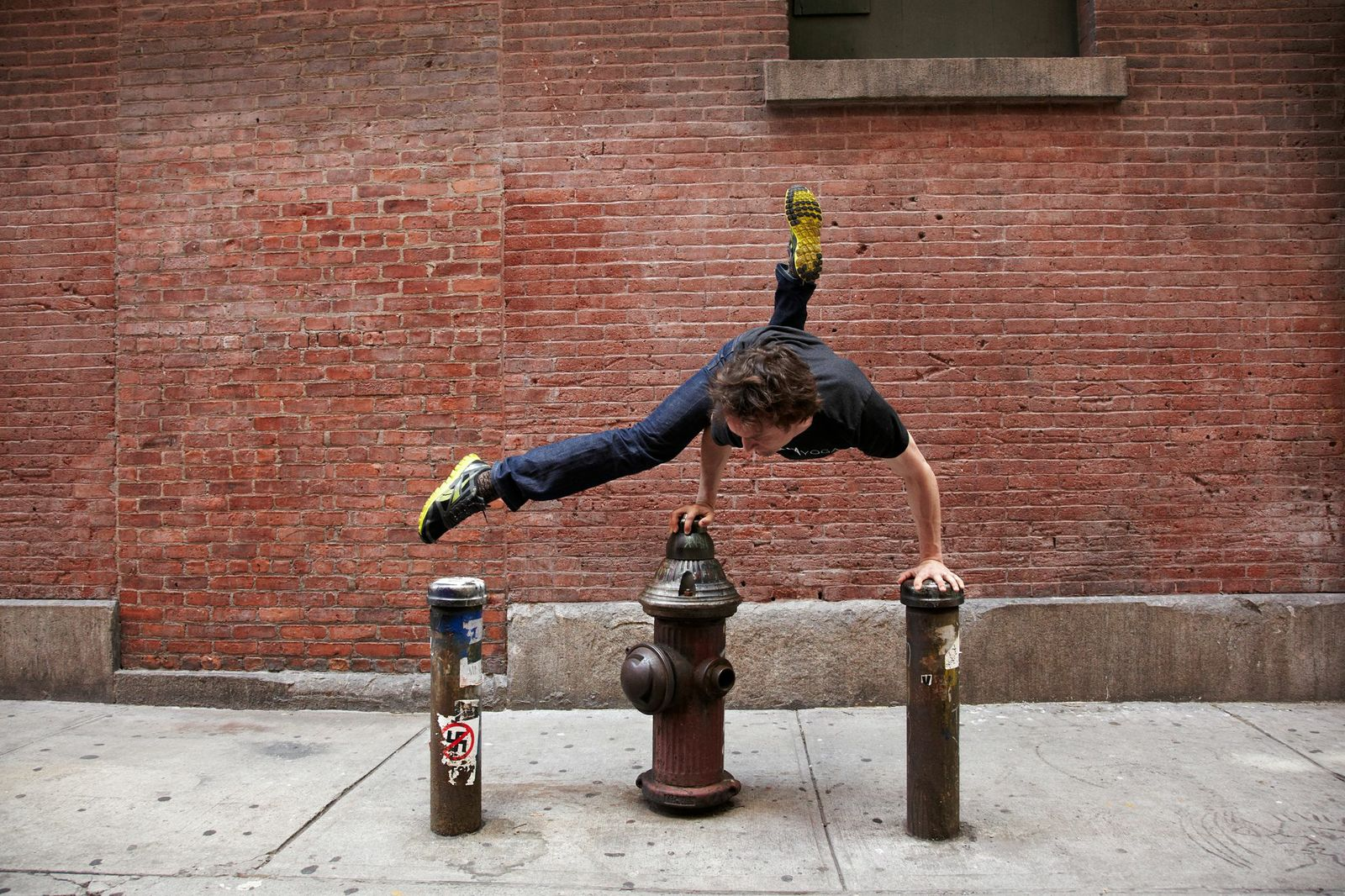 Mike in New York, doing hard things with ease. Photo via Strala Yoga.