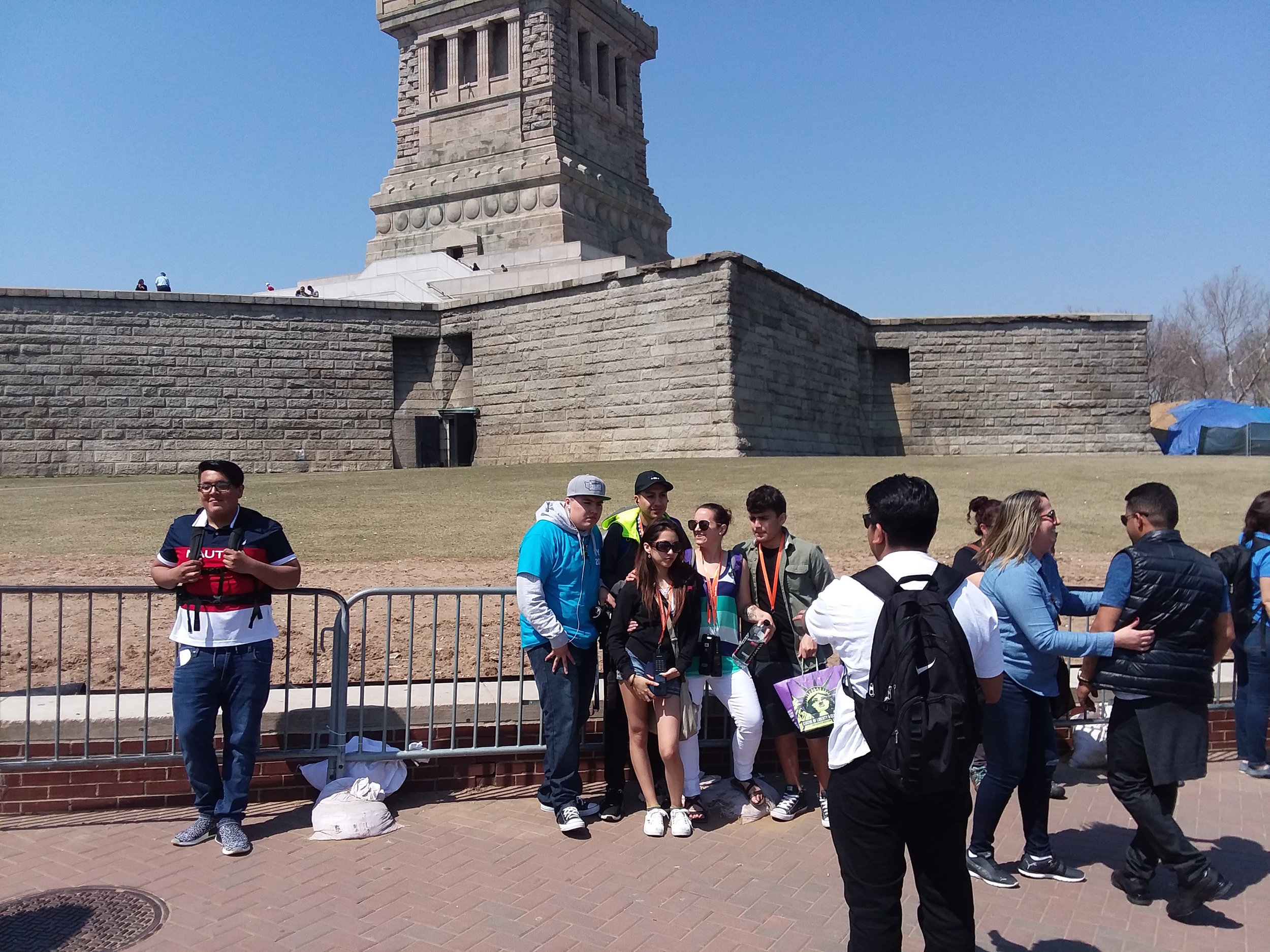 Students in front of the Statue of Liberty