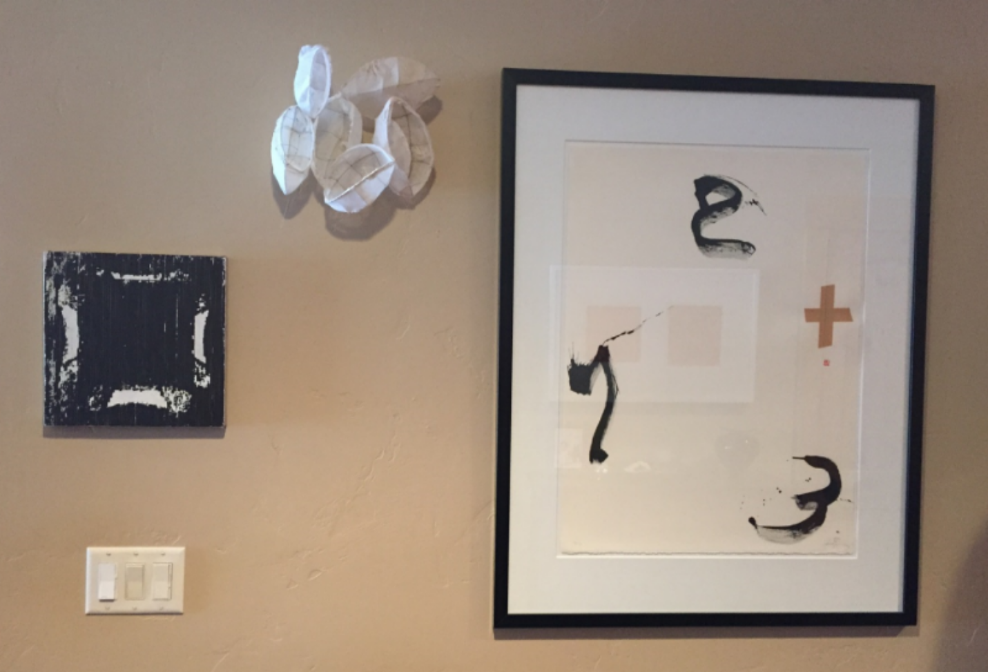 "The first artwork I purchased at right, a Tapies lithograph that wiped out my 19 year old self's bank account. Two recent purchases, a Gregor Hildebrandt cassette tape ""painting"" and relief sculpture by Alyssa Davies join it."