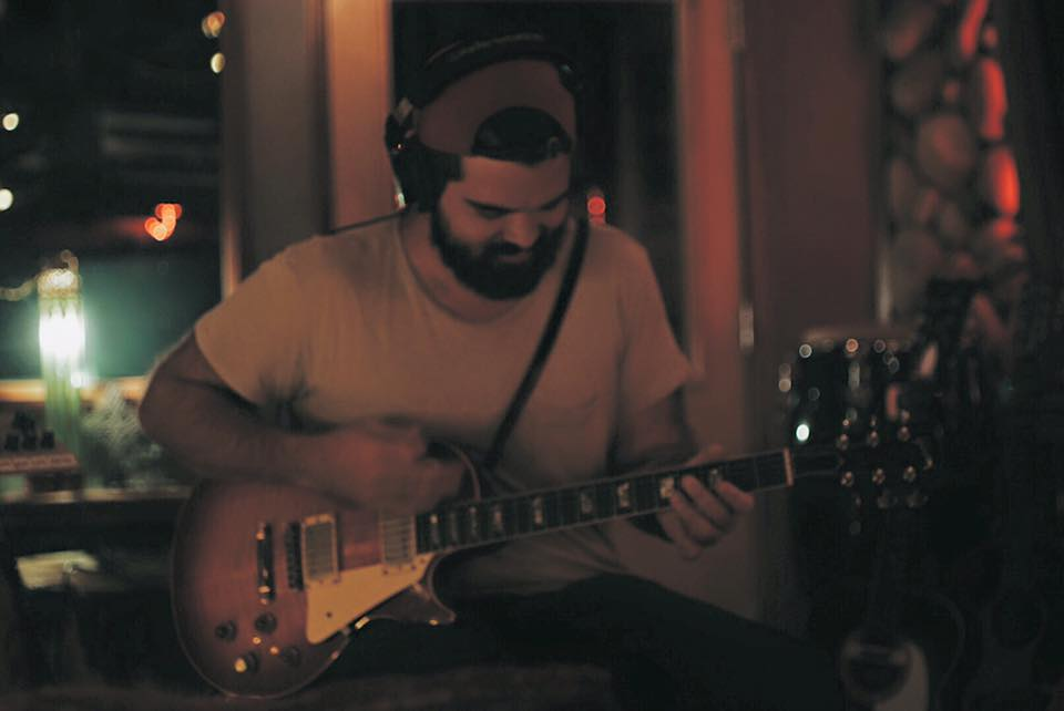 Payton on the guitar