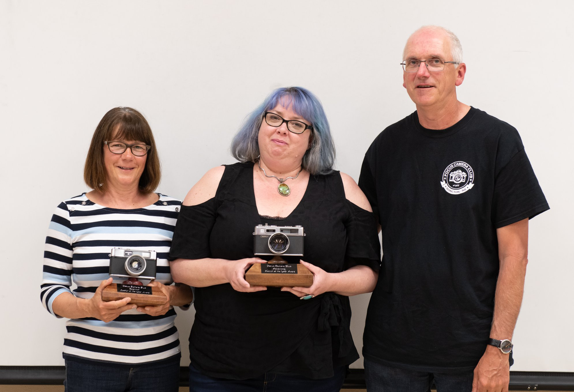 Receiving the Best New Recruit Award from the Moncton Focus Camera Club.
