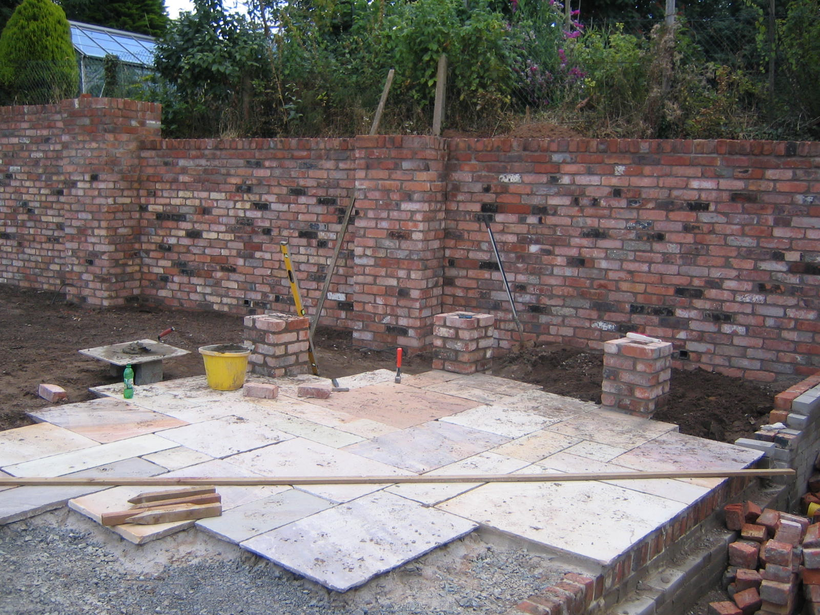 sandstone paving and reclaimed bricks in garden belfast