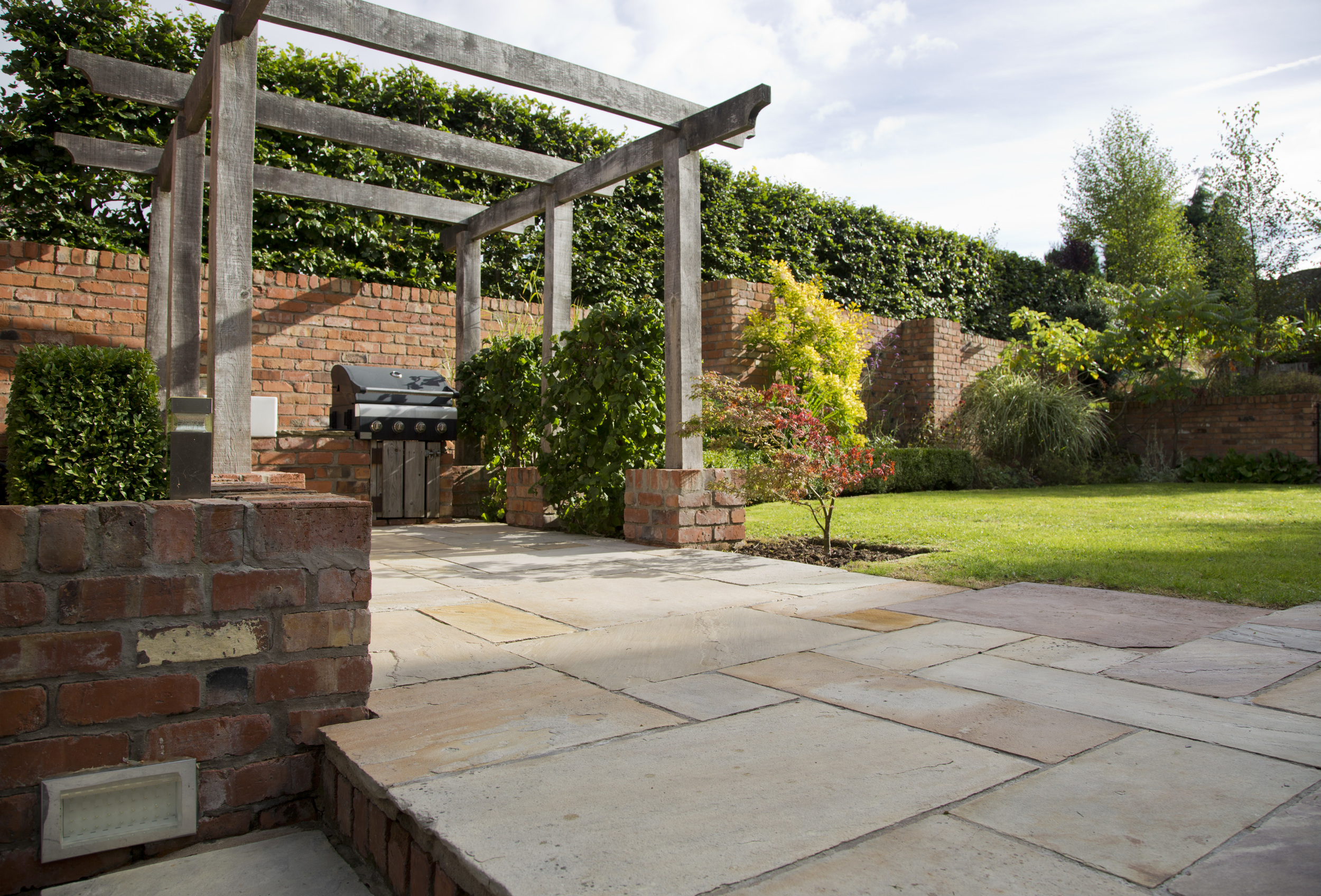 belfast landscaping and garden design with sandstone and oak pergola by peter dunn