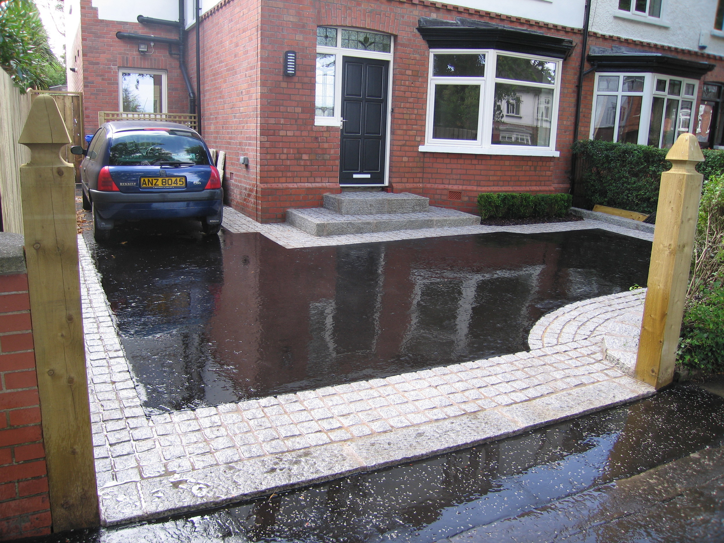 driveway construction with asphalt in Belfast