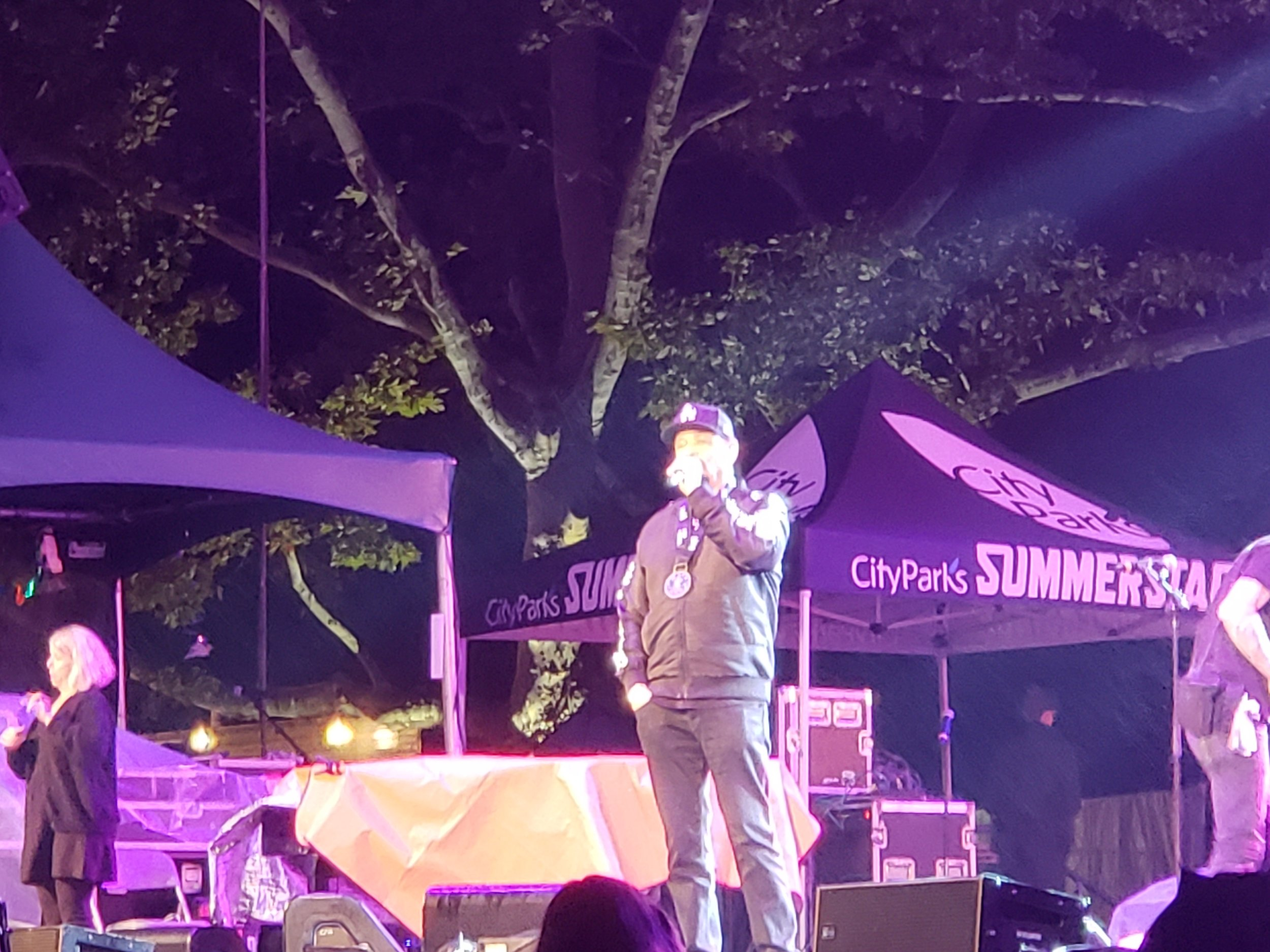 Ice T speaking at the No Barriers Concert with an ASL interpreter in the background.