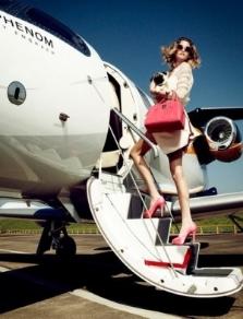 woman getting on plane.jpg