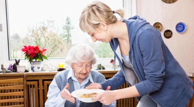 caregiver-helping-senior-lady-in-her-home-small2.jpg