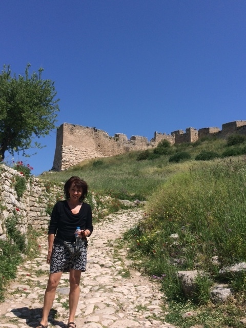Leslie in Corinth cobbled path.jpeg
