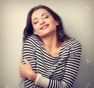 woman hugging herself.jpg