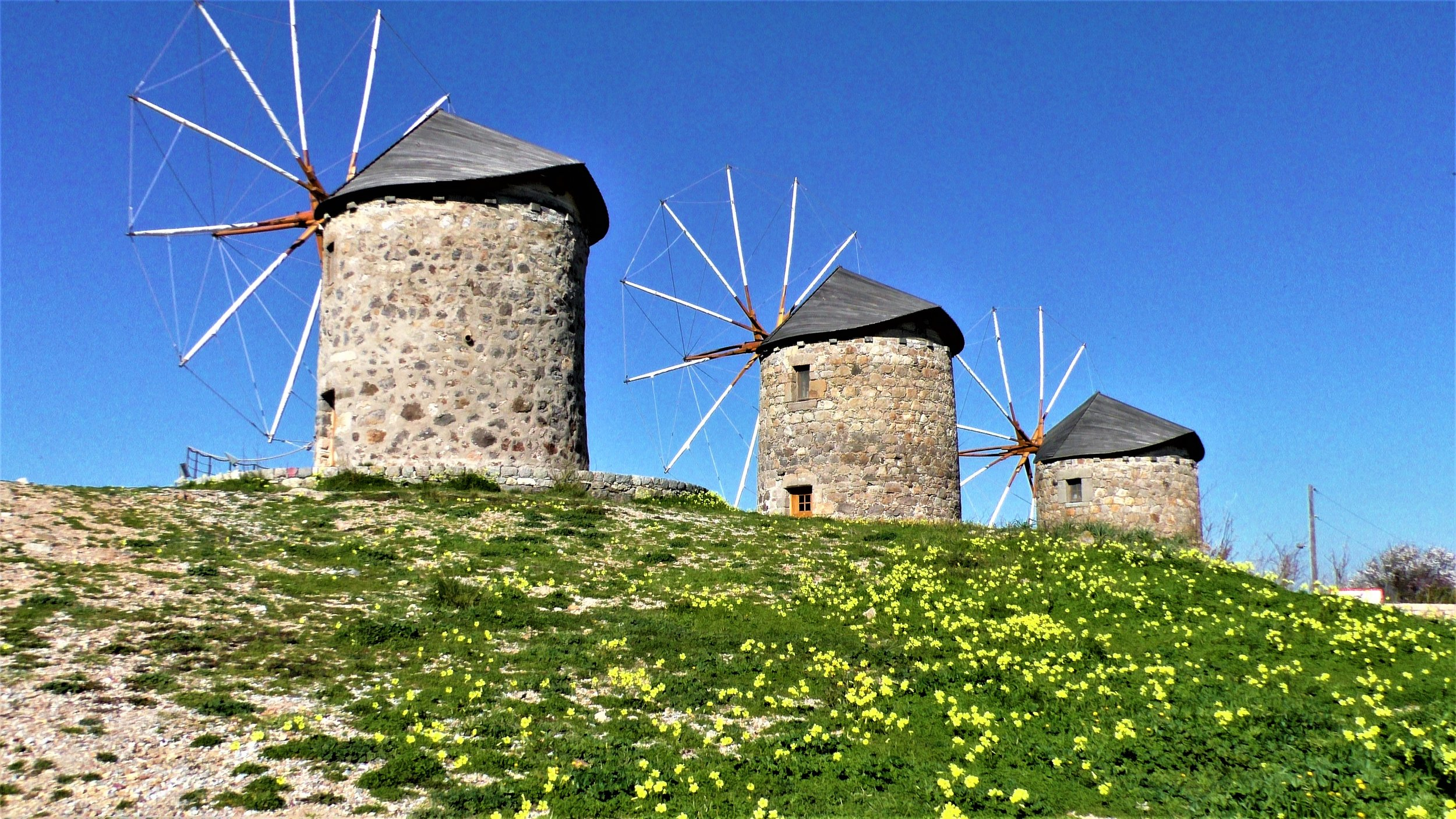 On Patmos, windmills rigged with sails. From the 16th century.