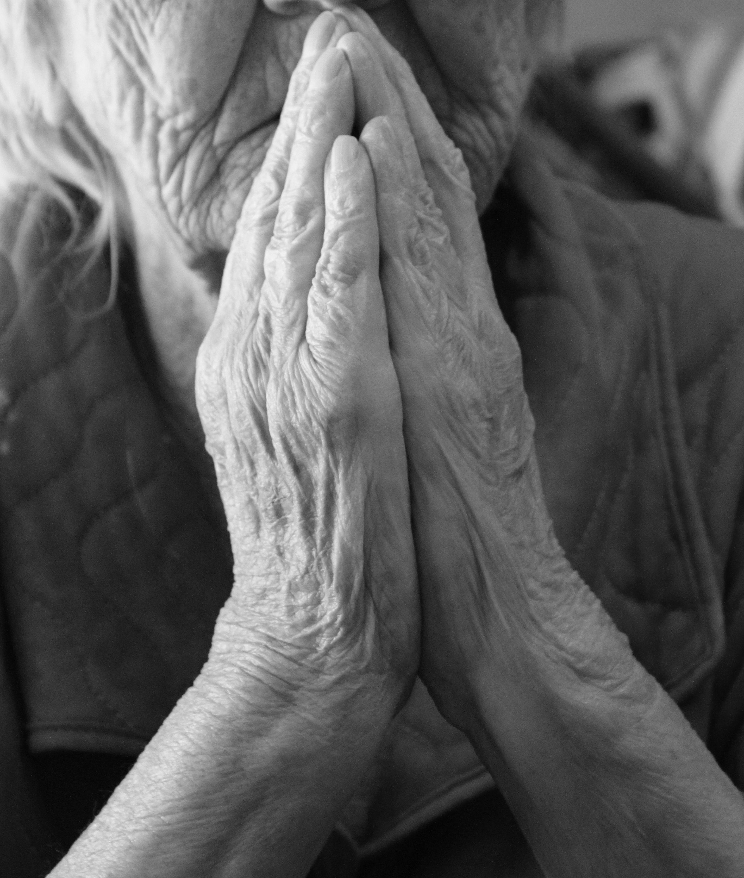 old woman praying.jpg