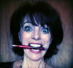 Leslie manic with pen in mouth.jpeg