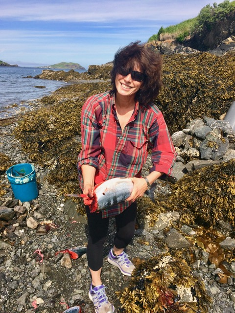 Leslie holding gutted salmon.jpeg