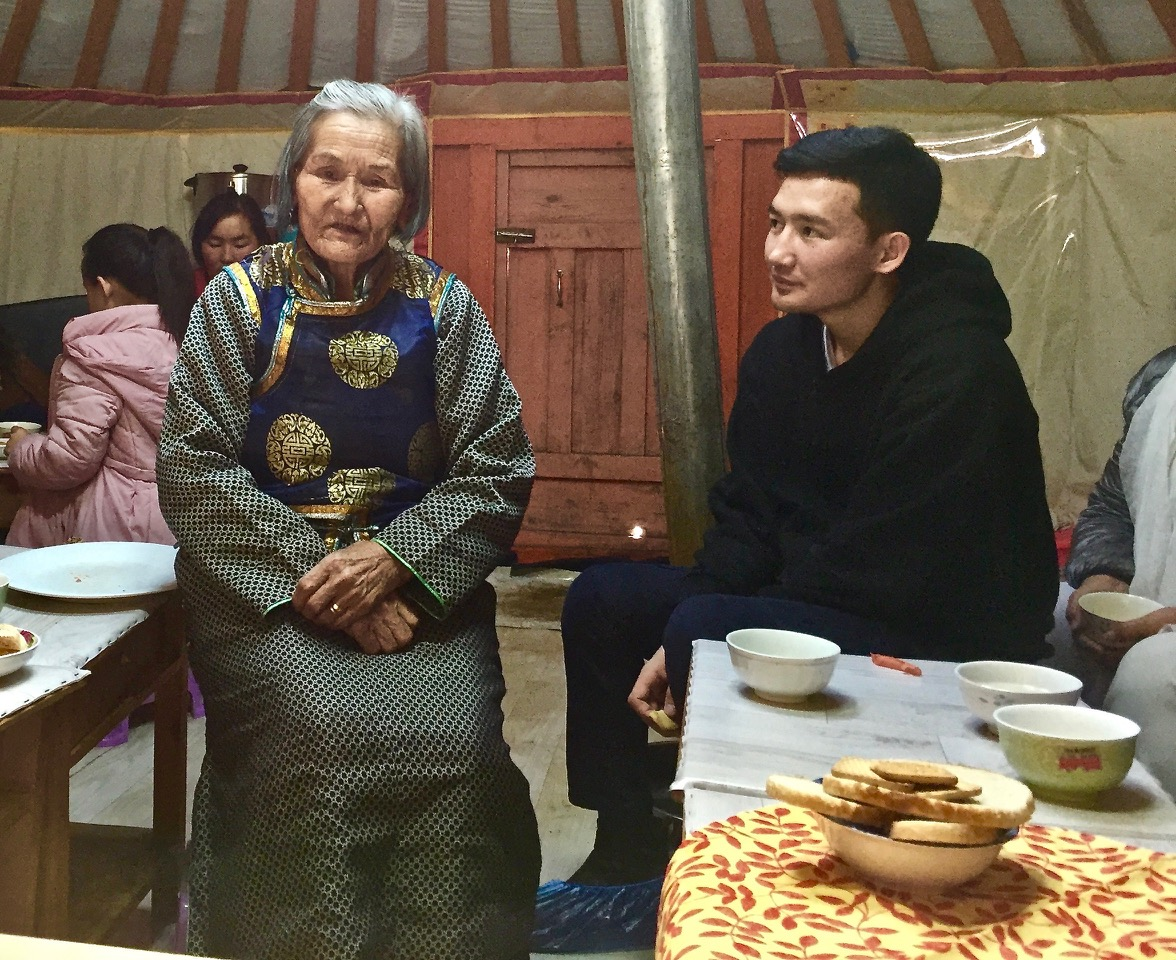 Mongolia--elderly woman in deel and boy.jpeg
