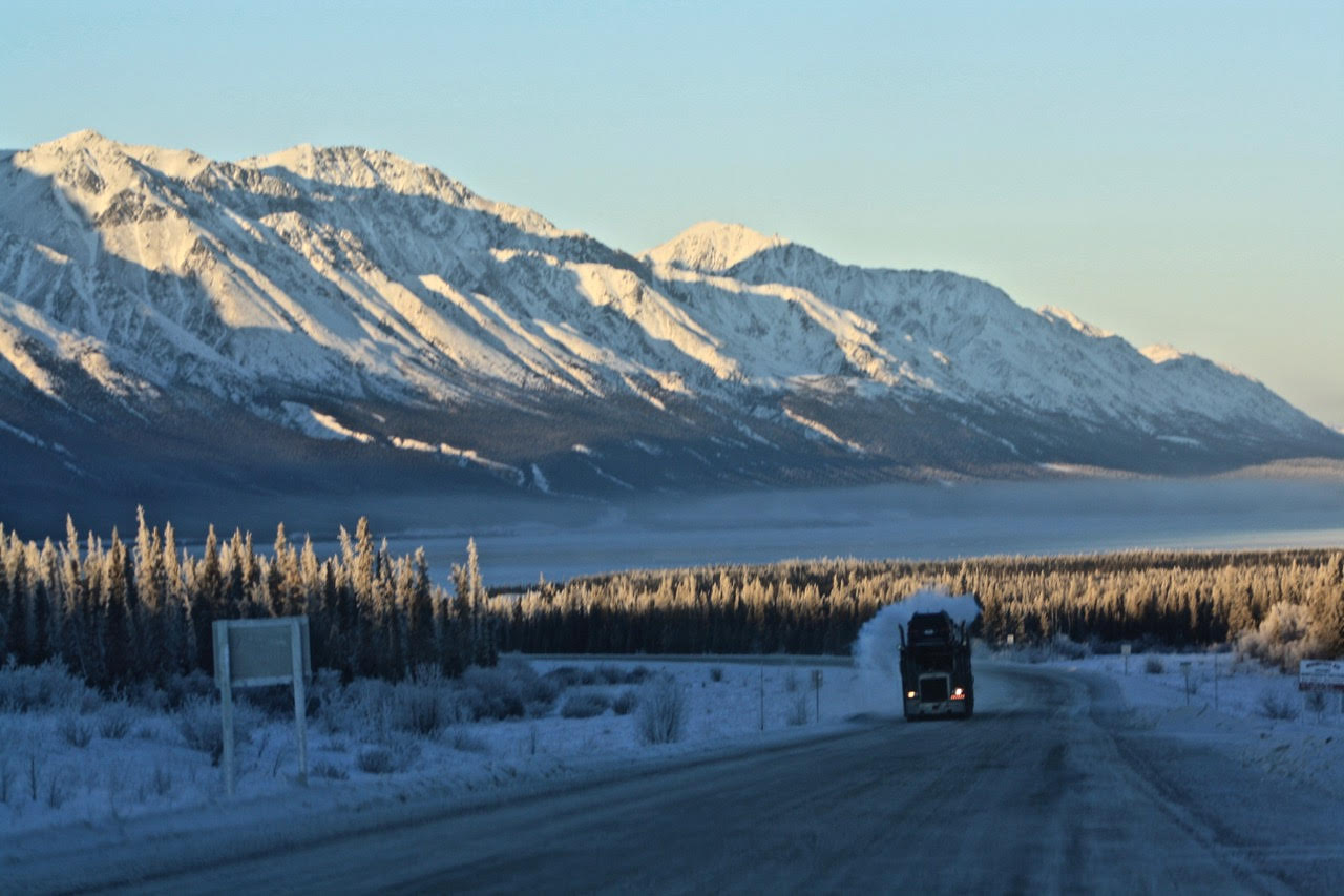 day seven---truck on road with high mountains.jpg