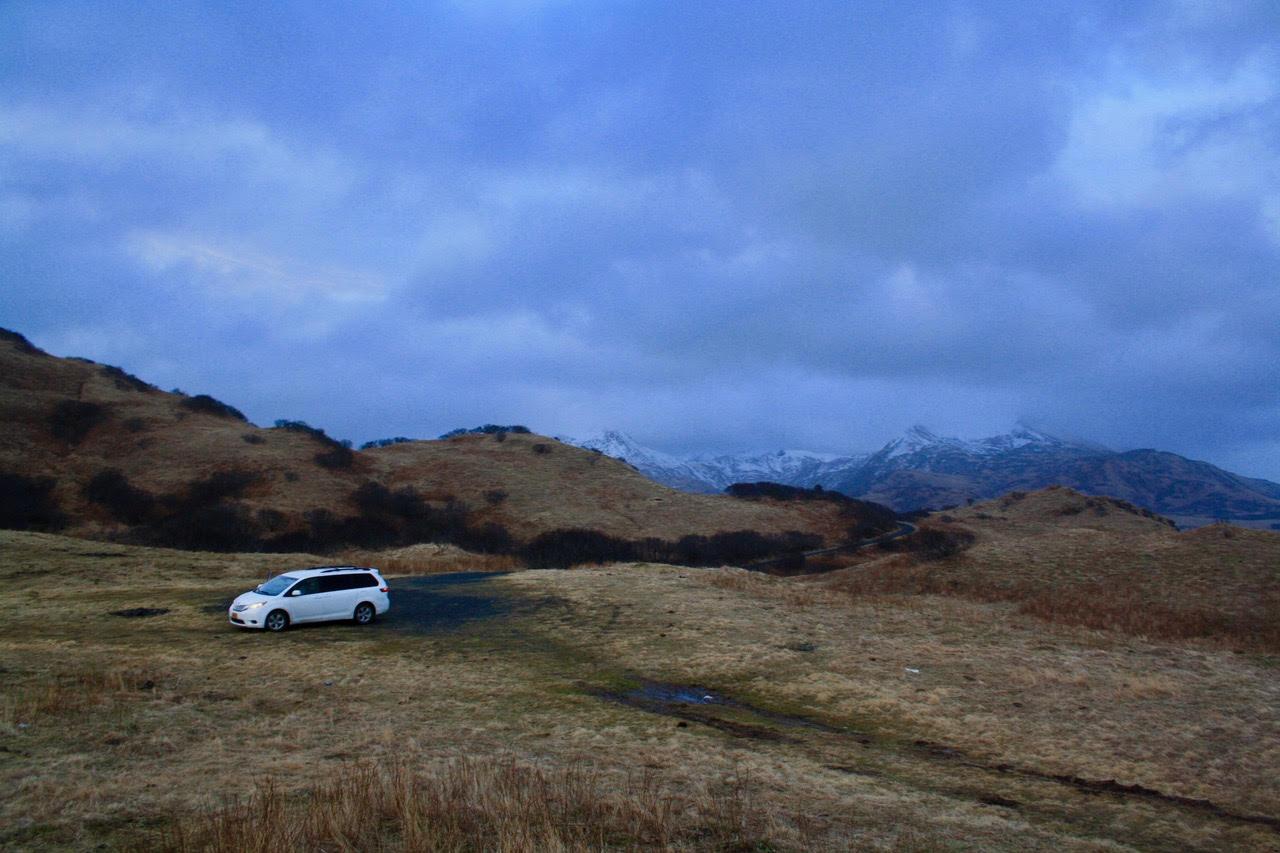A-white van in tawny hillsides.jpg