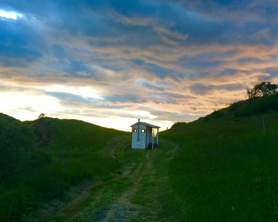 Outhouse with dramatic sky .jpg