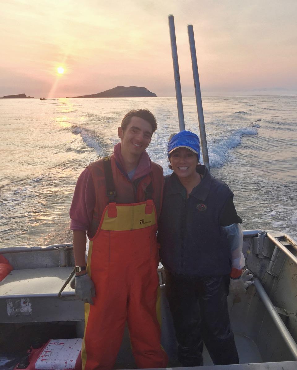 Abraham + Leslie in skiff, sunset.jpeg