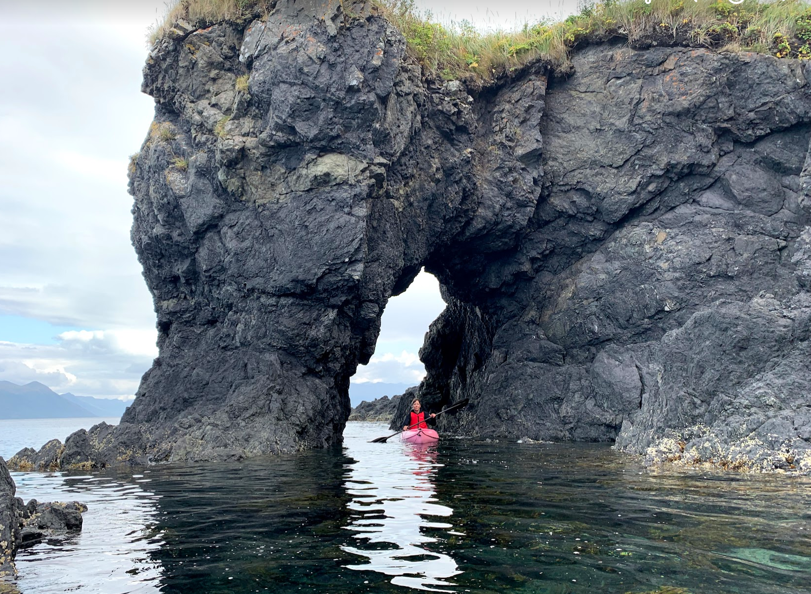 HIWW 2019 Robyn in kayak through arch.png