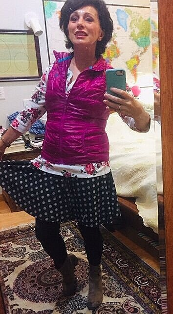 (How do you snap a photo by yourself? And I am indeed wearing flowers and polka-dots together today. Total cost of outfit: $23)  My thrift store ways now run in the family: