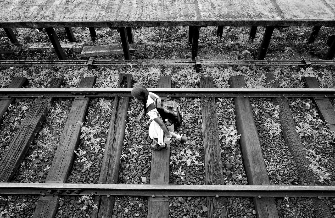 Sri Lankan school girl walks the tracks home.    Olympus OM-D E-M1 + 12-40mm f/2.8