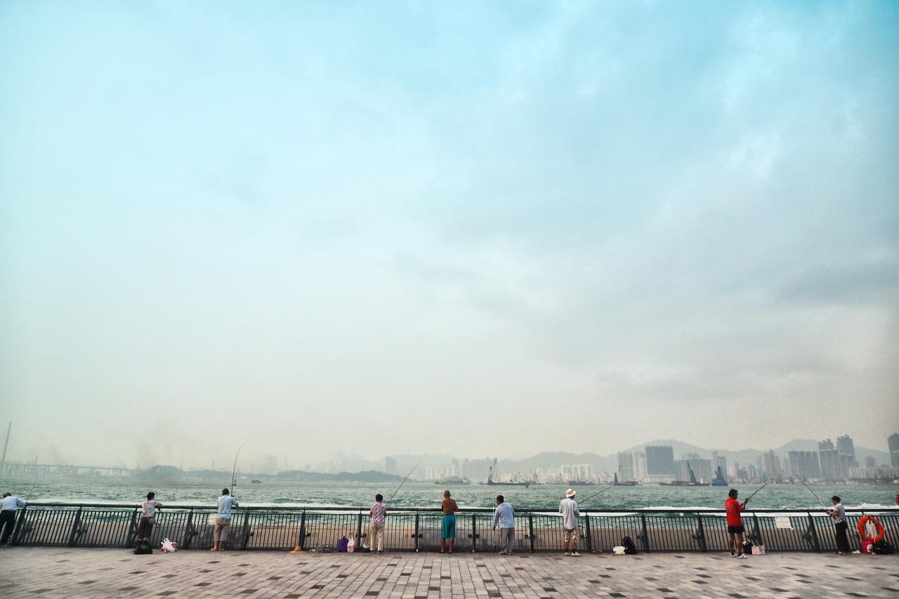 Fishing at  Sun Yat Sen Memorial Park  Promenade,  Hong Kong  .     Olympus AU OM-D E-M1 + 12-40mm f/2.8