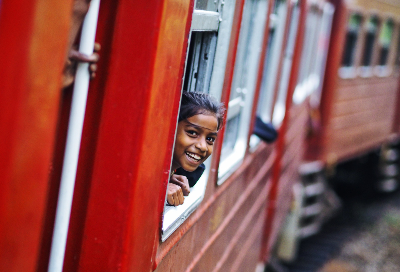 One of many photos from   Sri Lanka   that I will be sharing this week. This girl with the magical smile was captured during my train ride from Hatton to Ella.     She was shy at first and barely visible peering out the window, I simply waved and smiled and we shared many small moments and giggles. If I am able to somehow express how incredible the Sri Lankan people are it can be seen through this girl's smile.     Olympus OM-D E-M1 + 75mm f/1.8