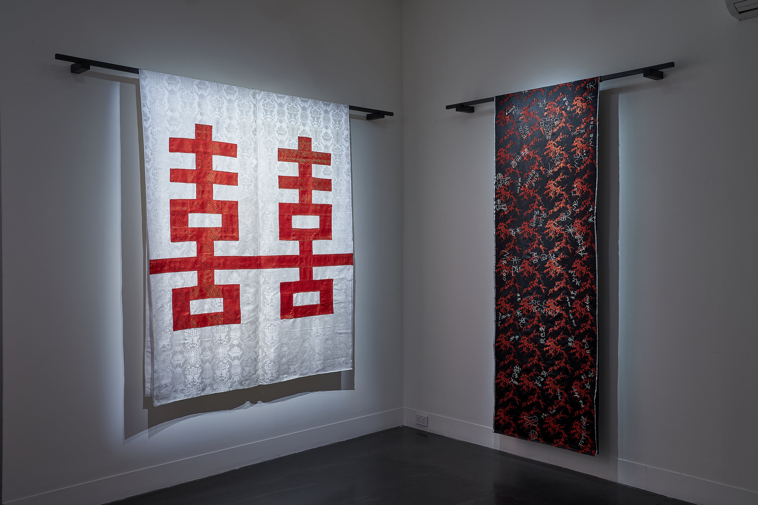 Double Happiness (Queer Love) (centre) ,  2019 Me Too 我也是Rice Bunny米兔   (right),   2019 Hand and and machine stitched brocade fabric, timber Photo: Sam Roberts