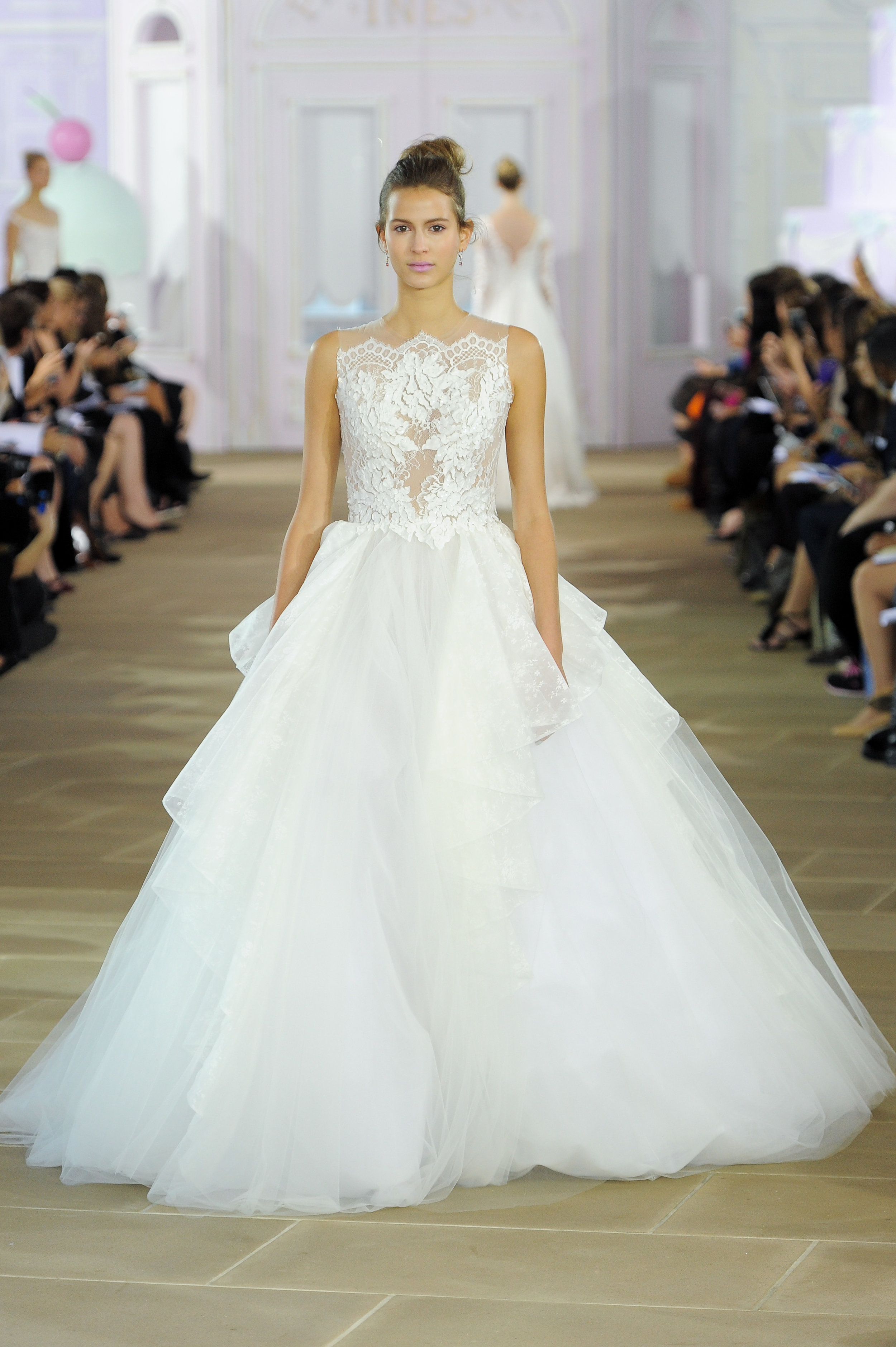 'Souffle' - sleeveless tulle ball gown with illusion bodice and back, lace appliqués and cascading tulle skirt and train.