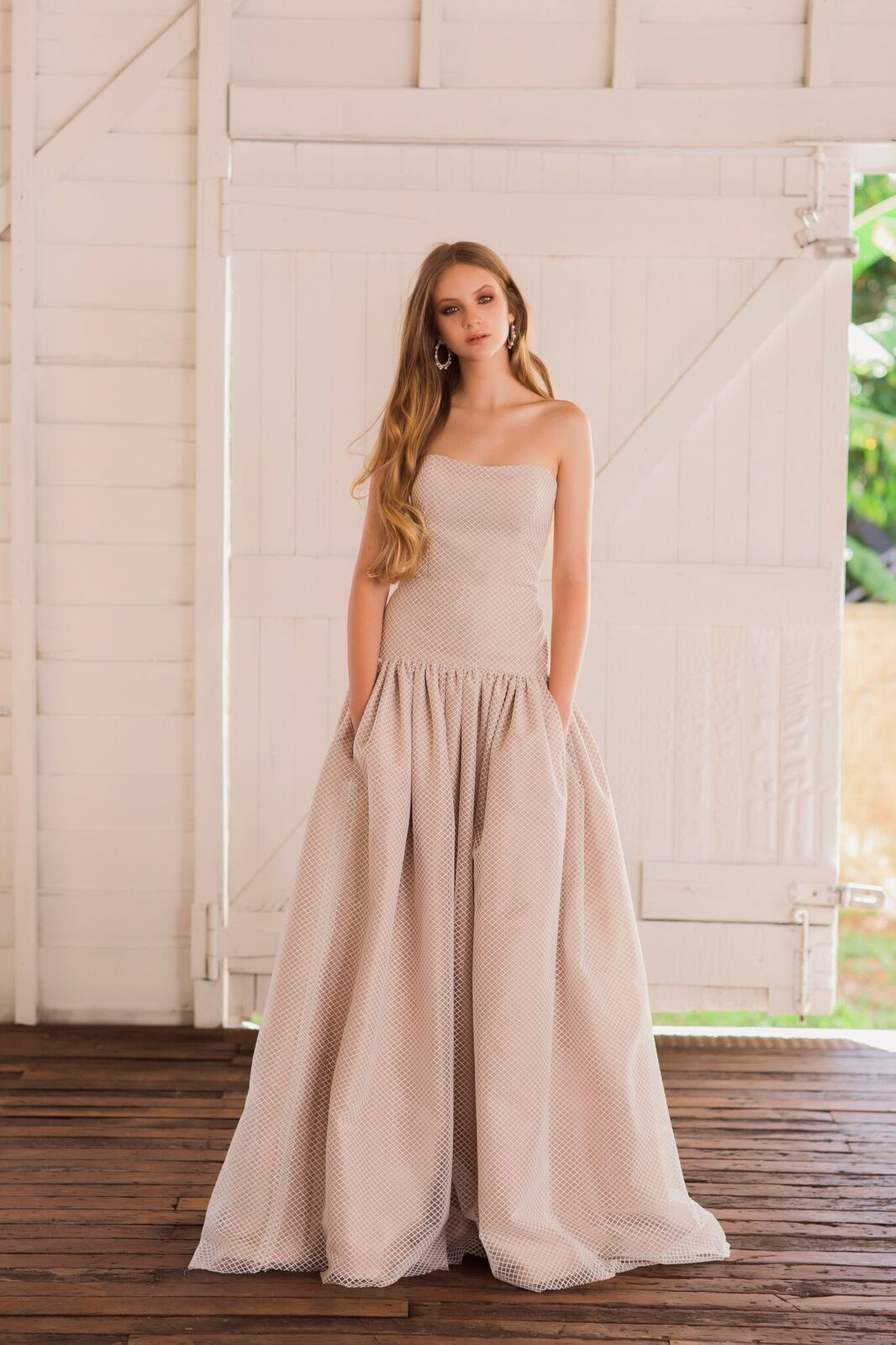 'Alegra' -s trapless drop-waist gown with diamond tulle over tea rose silk dupion and side pockets.