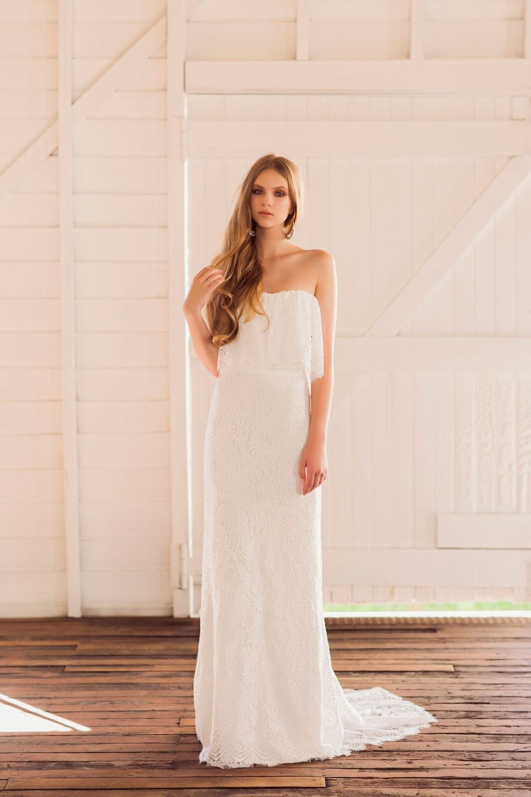 'Petra' -  f  lounce silk white lace bodice gown with slimline lace skirt with long train.