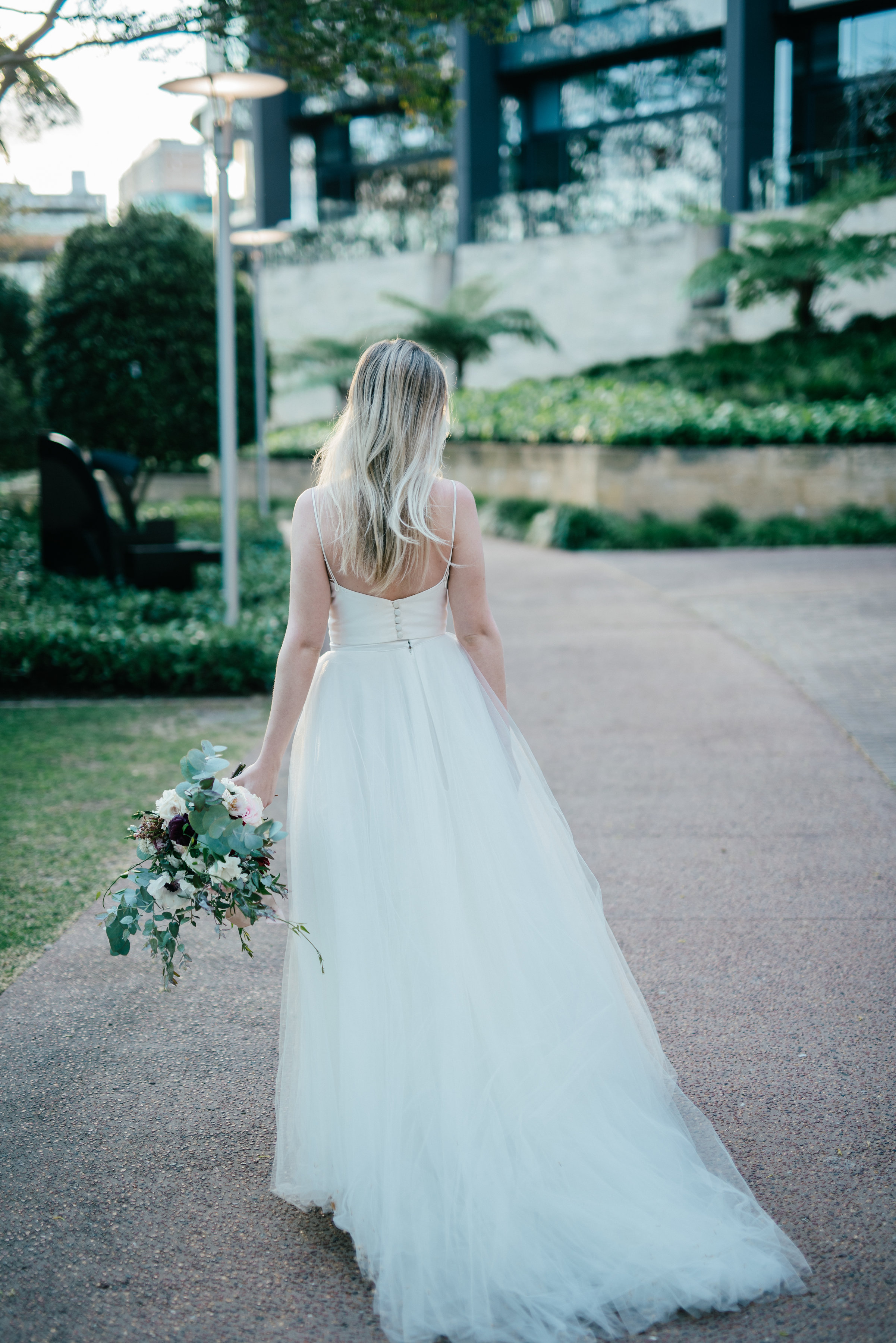 Model Courtney wears a Karen Willis Holmes gown with simple bodice and full tulle skirt finished with lace.