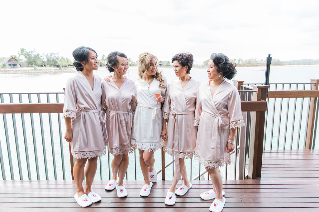 Mimi purchased satin robes from LeRose for herself, her bridesmaids, her sister and mother as well as personalised bottles of gin from Archie Rose Distilling Co.