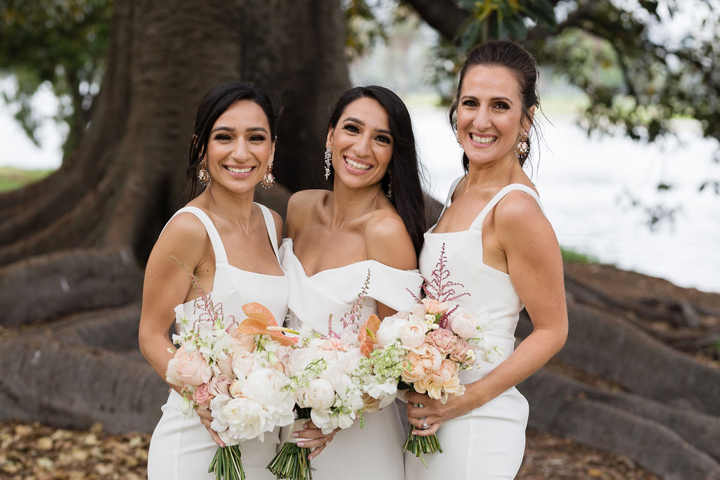 Stef's bridesmaids looked gorgeous in their structured fitted crepe dresses by Alex Perry.