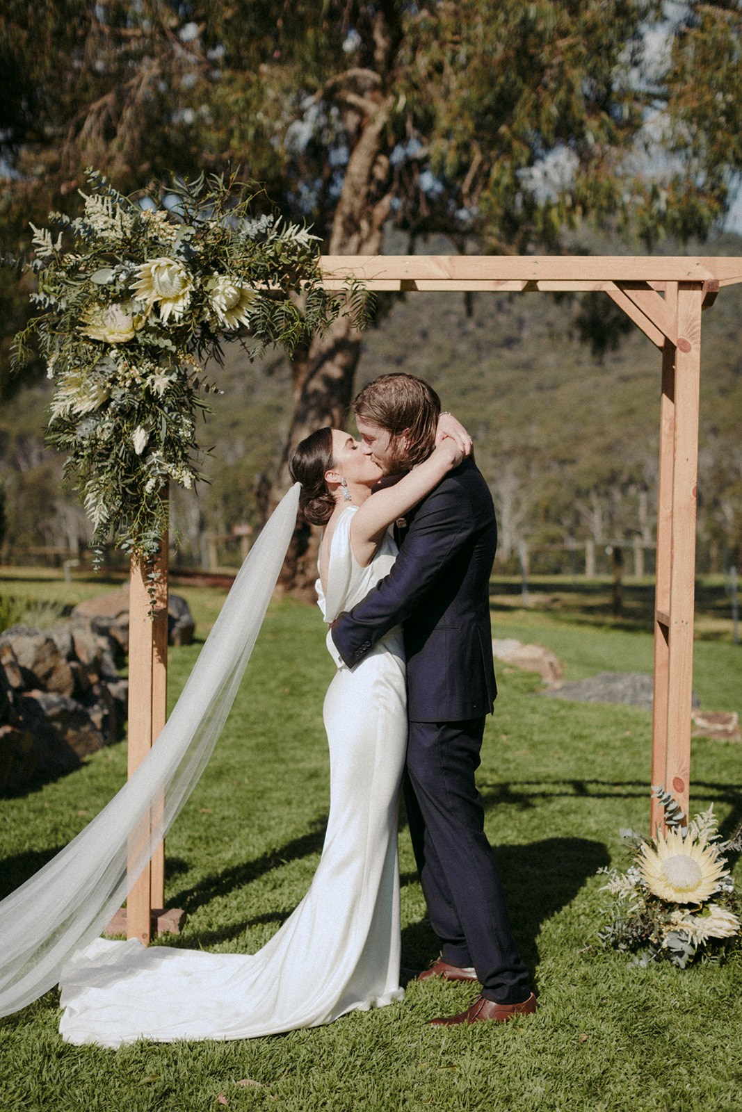 """With the help of a work friend, Tom lent his handiwork to making the ceremony arbour. """"The wooden feature arch will remain on the property for years to come."""""""