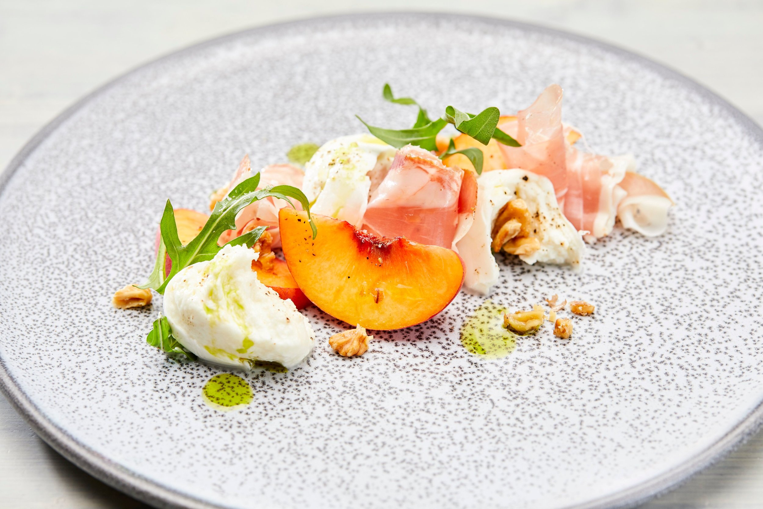 Metropolis Events - Buffalo mozzarella, yellow peaches, prosciutto di Parma, toasted walnuts, rocket leaves and basil infusion.jpeg