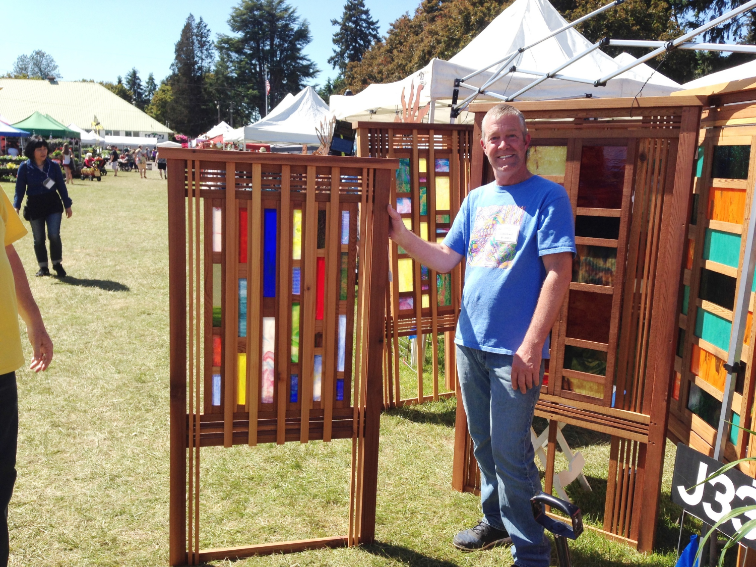 Carpentry and glass artist James Merrigan, of Portland OR, at the Canby Master Gardeners Fair 2016.